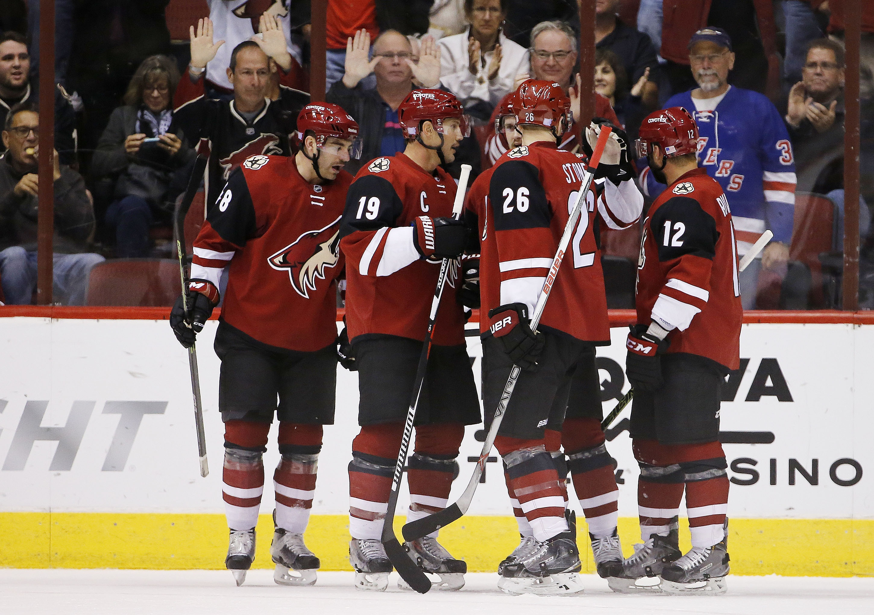 Arizona Coyotes' Oliver Ekman-Larsson, of Sweden, celebrates his goal against the Edmonton Oilers with teammates Jordan Martinook, left, Shane Doan (19), Michael Stone (26) and Brad Richardson (12) during the first period of an NHL hockey game Thursday, N