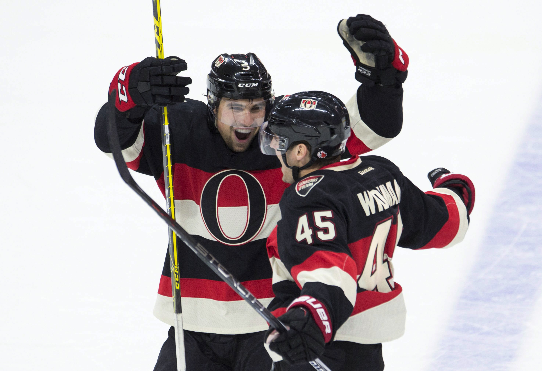 Ottawa Senators defenseman Cody Ceci congratulates Chris Wideman (45) on his goal against the Vancouver Canucks during the third period of an NHL hockey game Thursday, Nov. 12, 2015, in Ottawa, Ontario. (Adrian Wyld/The Canadian Press via AP)