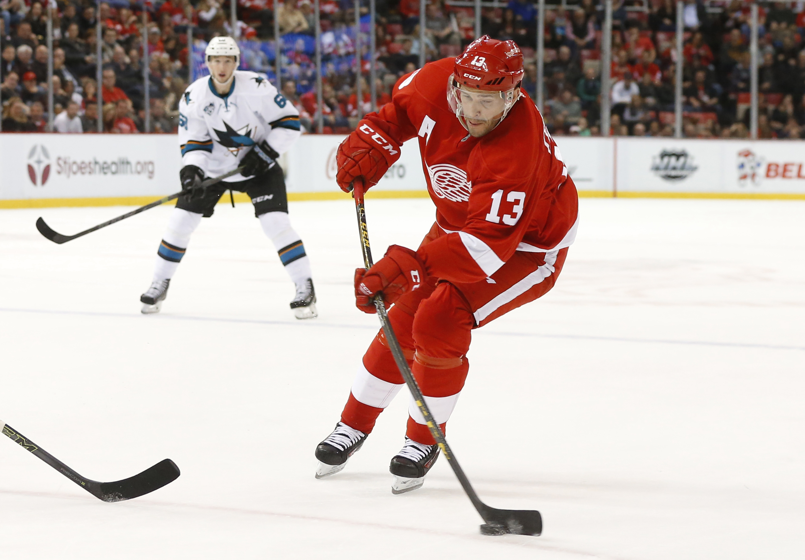 Detroit Red Wings' Pavel Datsyuk shoots against the San Jose Sharks in the second period of an NHL hockey game Friday, Nov. 13, 2015 in Detroit. (AP Photo/Paul Sancya)