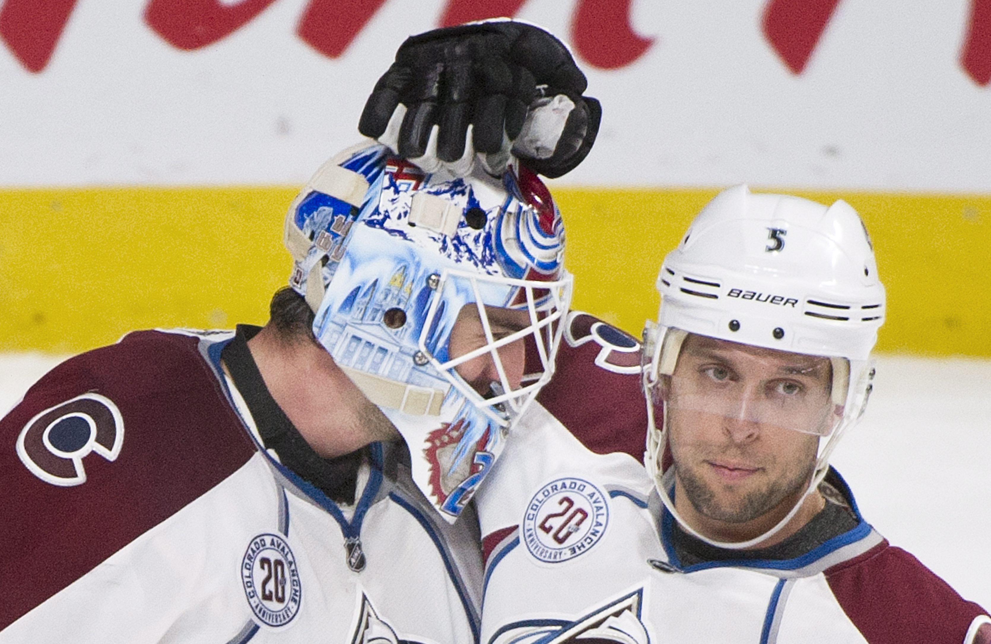 Colorado Avalanche goaltender Reto Berra, left, celebrates with teammate Nate Guenin after defeating the Montreal Canadiens in an NHL hockey game in Montreal, Saturday, Nov. 14, 2015. (Graham Hughes/The Canadian Press via AP) MANDATORY CREDIT