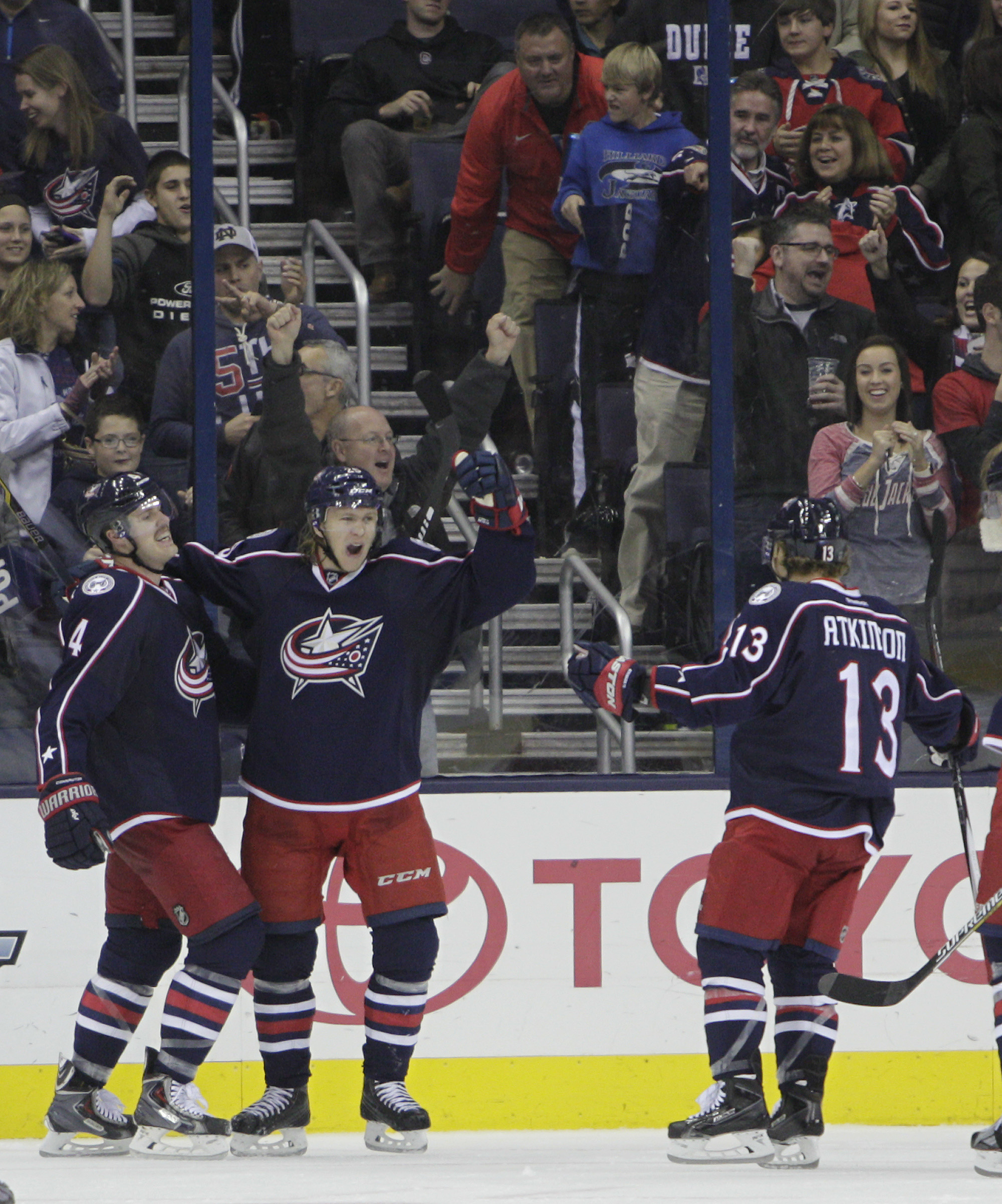 Columbus Blue Jackets' William Karlsson, center, of Sweden, celebrates his goal against the Arizona Coyotes with teammates Kevin Connauton, left, and Cam Atkinson during the third period of an NHL hockey game Saturday, Nov. 14, 2015, in Columbus, Ohio. Th