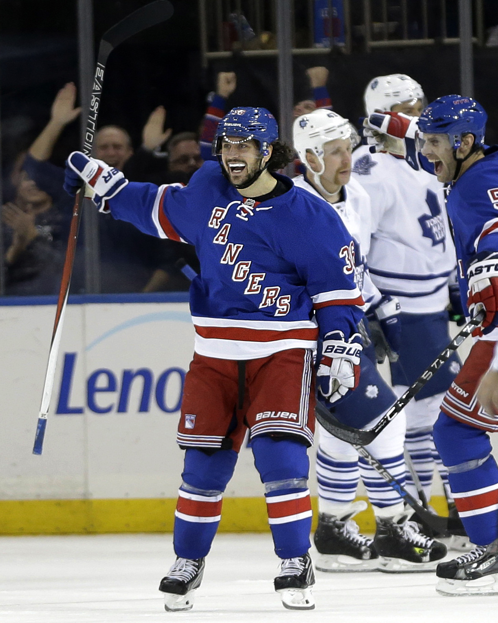 New York Rangers' Mats Zuccarello, left, celebrates his goal during the third period of an NHL hockey game against the New York Rangers on Sunday, Nov. 15, 2015, in New York. The Rangers defeated the Maple Leafs 4-3. (AP Photo/Seth Wenig)