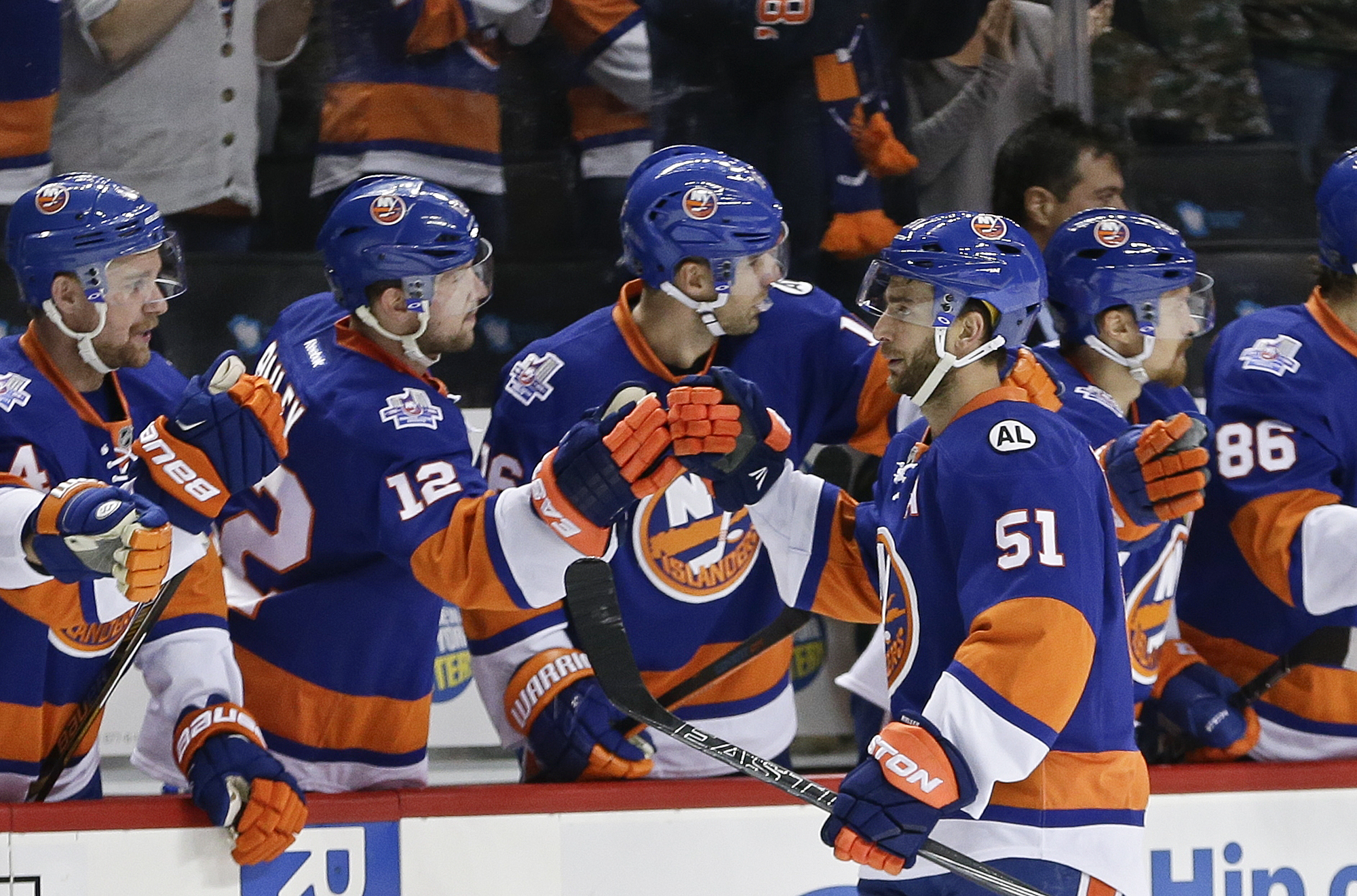 New York Islanders' Frans Nielsen (51) celebrates with teammates after scoring a goal during the first period of an NHL hockey game against the Arizona Coyotes Monday, Nov. 16, 2015, in New York. (AP Photo/Frank Franklin II)