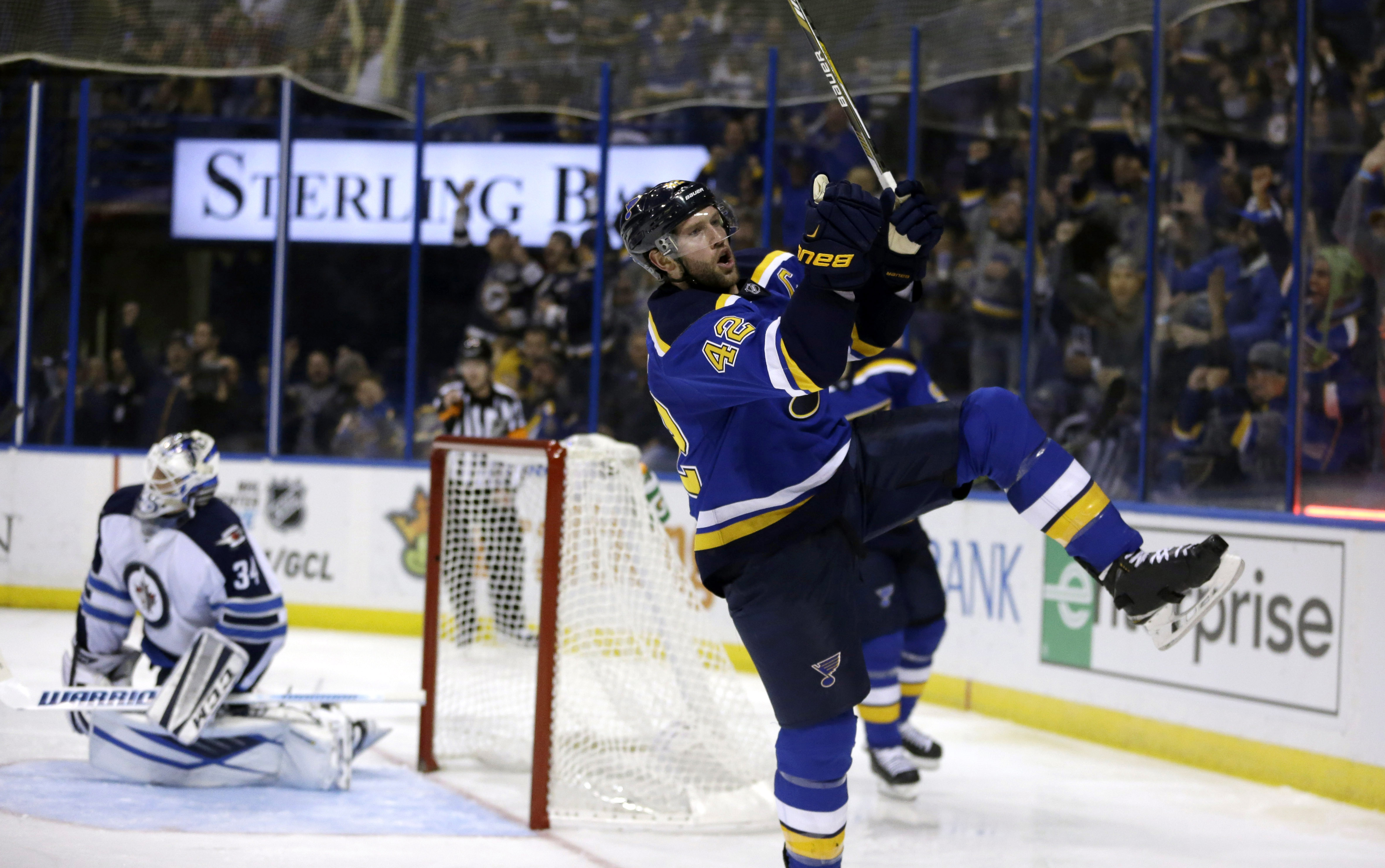 St. Louis Blues' David Backes celebrates after scoring past Winnipeg Jets goalie Michael Hutchinson, left, during the second period of an NHL hockey game Monday, Nov. 16, 2015, in St. Louis. (AP Photo/Jeff Roberson)
