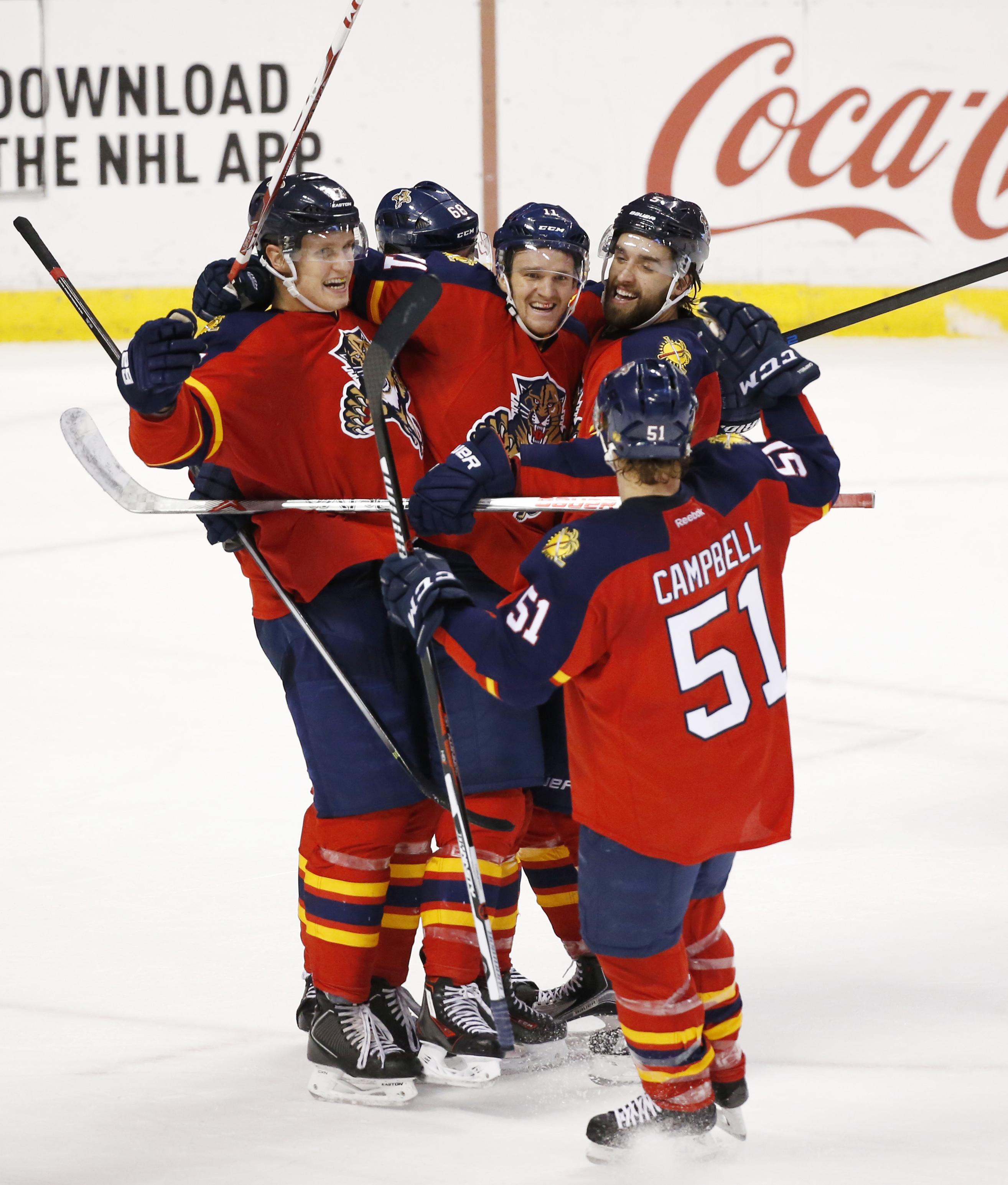 Florida Panthers players celebrate after center Nick Bjugstad, far left, scored a goal during the third period of an NHL hockey game against the Tampa Bay Lightning, Monday, Nov. 16, 2015 in Sunrise, Fla. The Panthers won 1-0. (AP Photo/Wilfredo Lee)