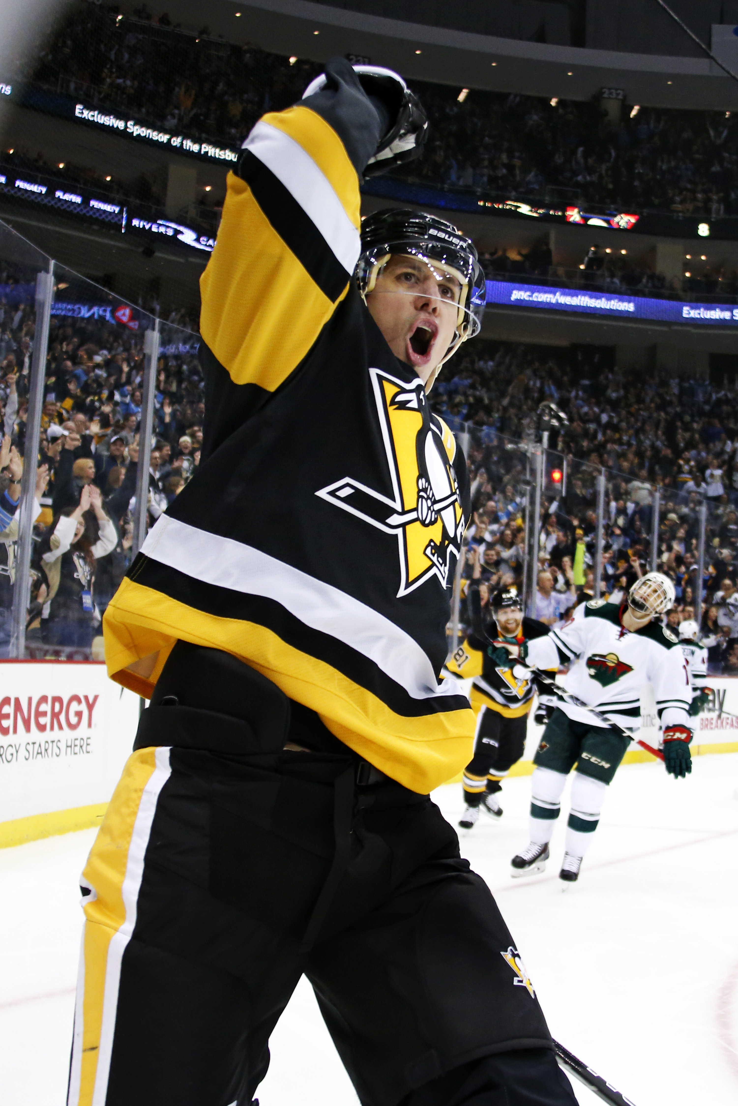 Pittsburgh Penguins' Evgeni Malkin (71) celebrates his goal in the second period of an NHL hockey game against the Minnesota Wild in Pittsburgh, Tuesday, Nov. 17, 2015. (AP Photo/Gene J. Puskar)