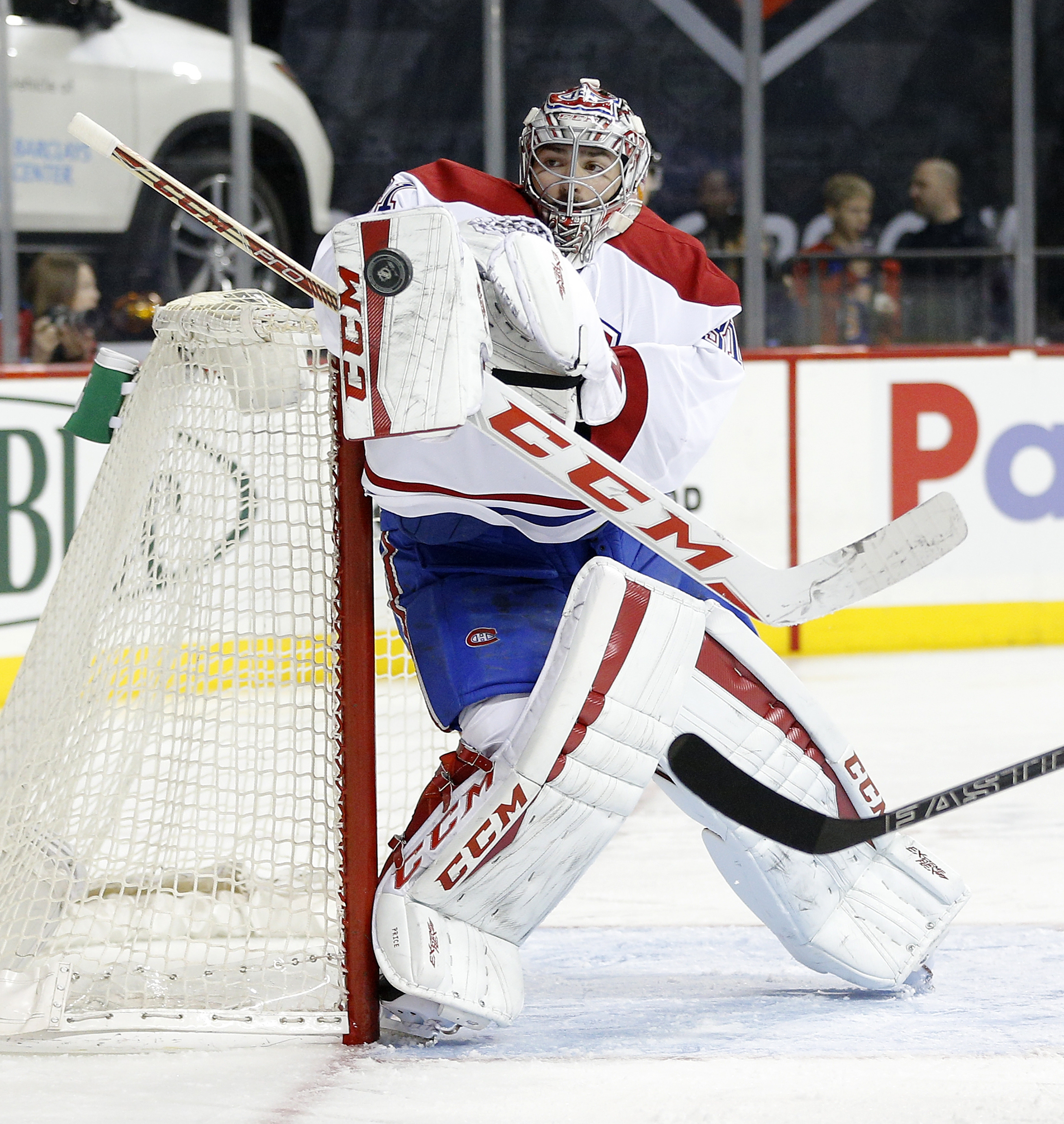 Montreal Canadiens goalie Carey Price stops a shot during the second period of an NHL hockey game against the New York Islanders on Friday, Nov. 20, 2015, in New York  (AP Photo/Paul Bereswill)