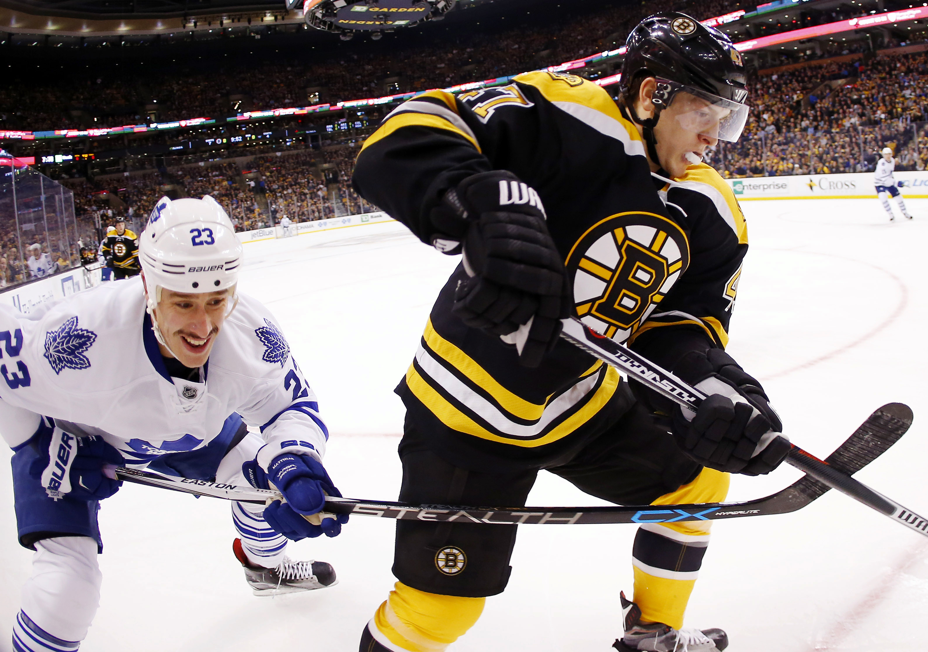Toronto Maple Leafs' Shawn Matthias (23) battles Boston Bruins' Torey Krug during the first period of an NHL hockey game in Boston, Saturday, Nov. 21, 2015. (AP Photo/Winslow Townson)