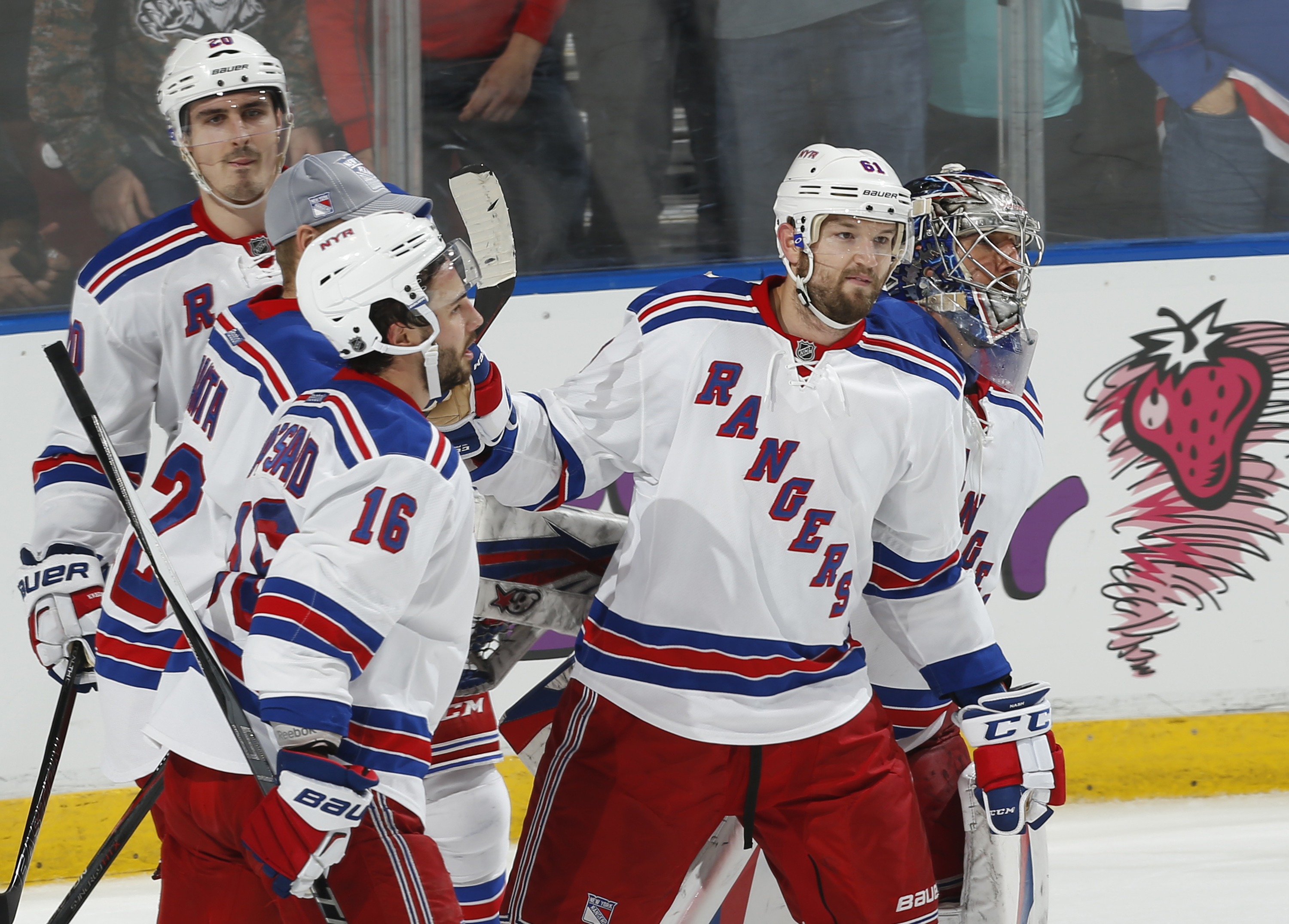 New York Rangers forward Rick Nash (61) skates off the ice with goaltender Henrik Lundqvist, right, and center Derick Brassard (16) after scoring the game-winning goal during the overtime  period of an NHL hockey game against the Florida Panthers, Saturda