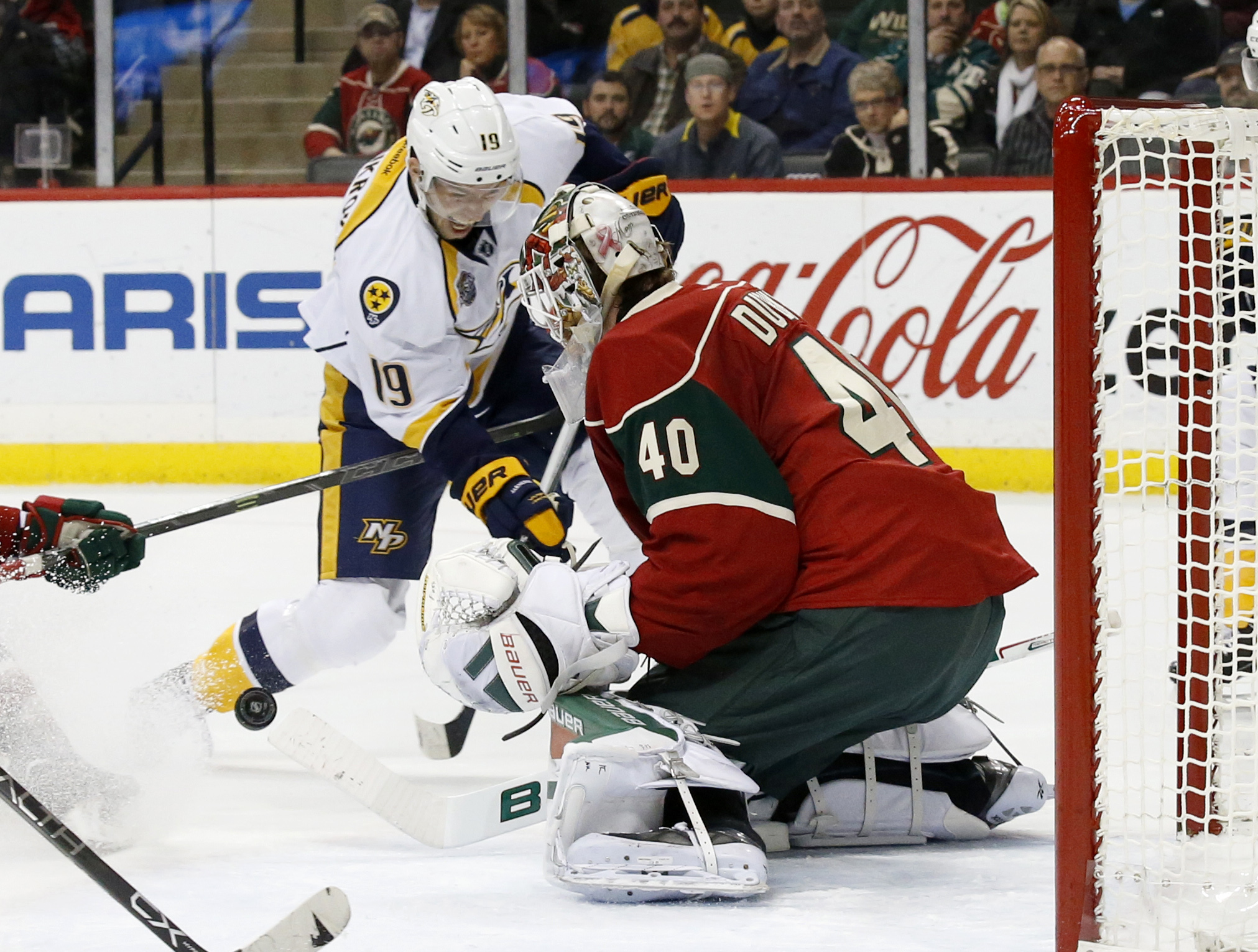 Minnesota Wild goalie Devan Dubnyk (40) deflects a point-blank shot by Nashville Predators center Calle Jarnkrok (19), of Sweden, during the second period of an NHL hockey game in St. Paul, Minn., Saturday, Nov. 21, 2015. (AP Photo/Ann Heisenfelt)