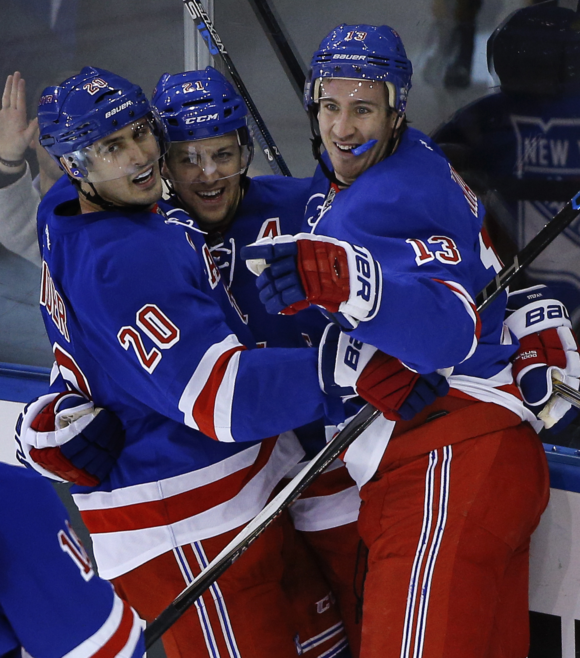 New York Rangers left wing Chris Kreider (20), center Derek Stepan (21) and right wing Kevin Hayes (13) celebrate after Stepan scored a goal against the Nashville Predators during the third period of an NHL hockey game, Monday, Nov. 23, 2015, in New York.