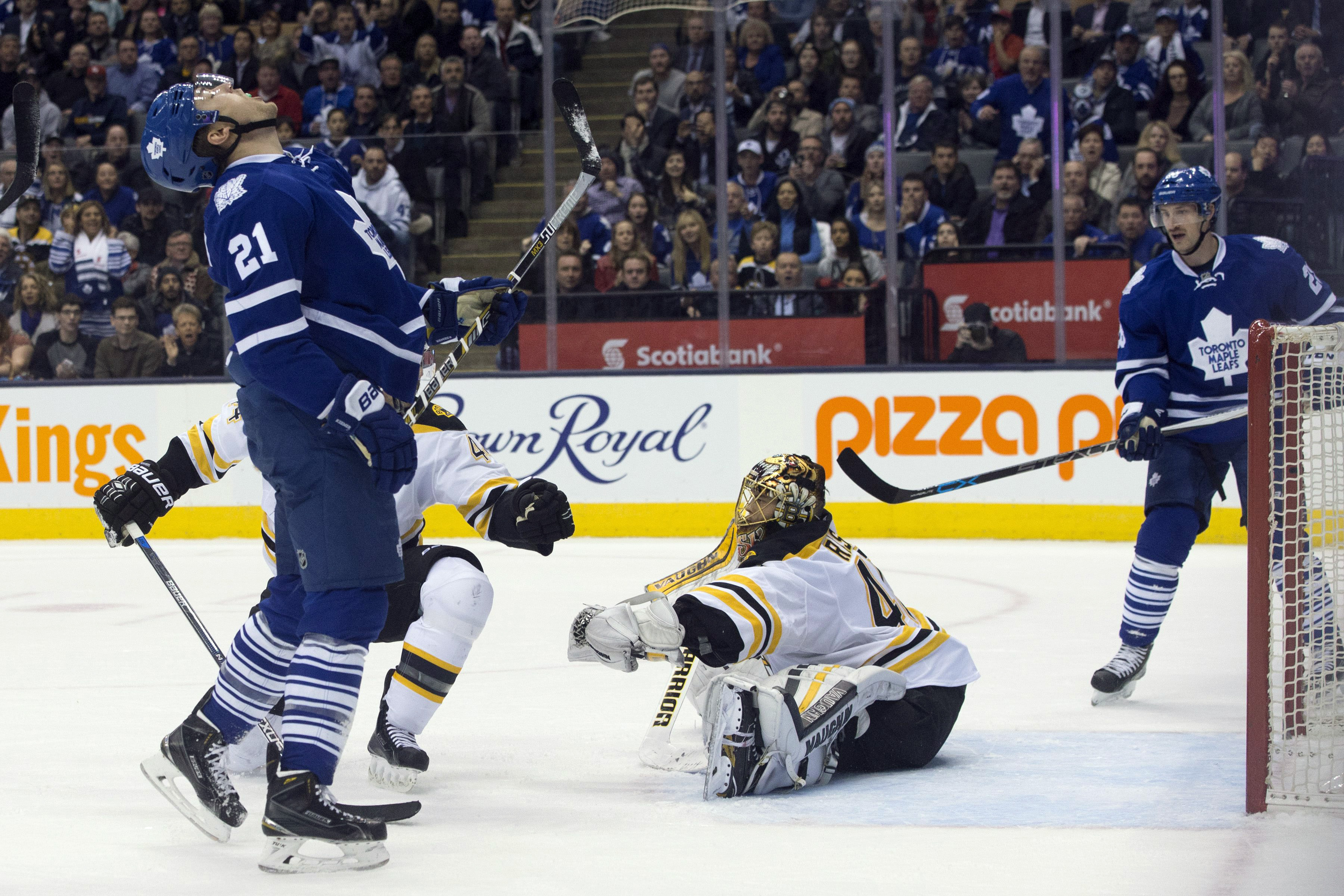Toronto Maple Leafs James van Riemsdyk, left, reacts after Boston Bruins goaltender Tuuka Rask makes a save at the end of overtime in an NHL hockey game in Toronto on Monday, Nov. 23, 2015. (Chris Young/The Canadian Press via AP) MANDATORY CREDIT