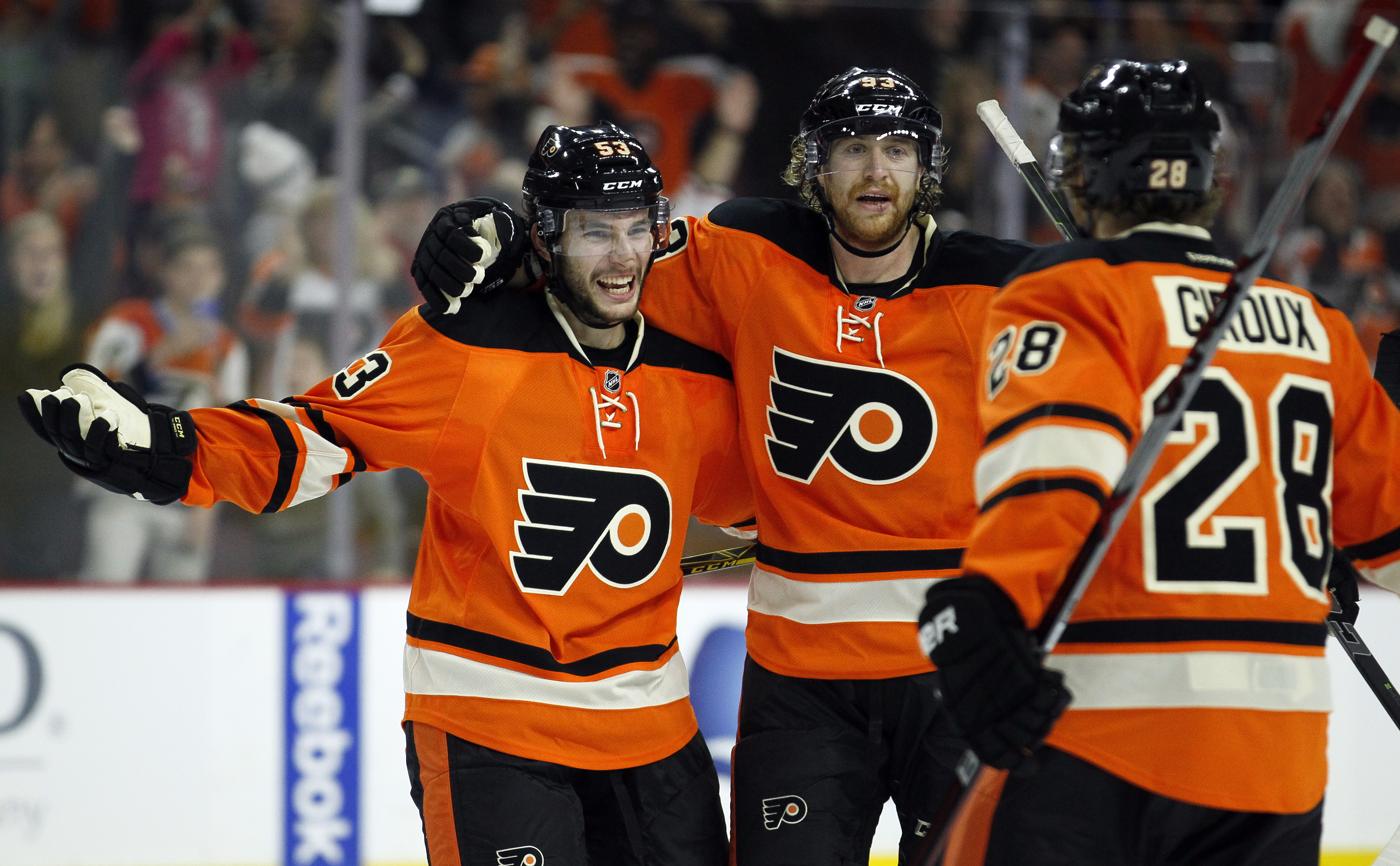 Philadelphia Flyers' Shayne Gostisbehere, left, who scored the winning goal, and Jakub Voracek, center, begin celebrating as Claude Giroux joins them at the end of the overtime period of an NHL hockey game against the Nashville Predators, Friday, Nov. 27,