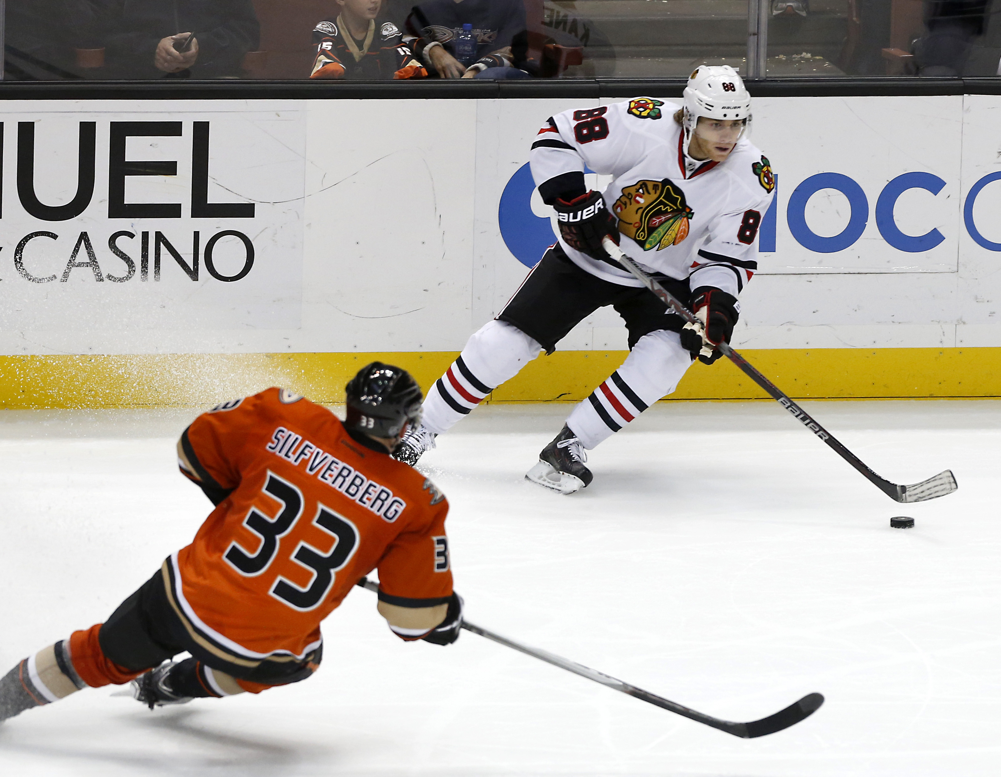 Chicago Blackhawks right wing Patrick Kane (88) looks to pass as Anaheim Ducks' Jakob Silfverberg (33) defends during the third period of an NHL hockey game in Anaheim, Calif., Friday, Nov. 27, 2015. Chicago won in overtime 3-2. (AP Photo/Christine Cotter