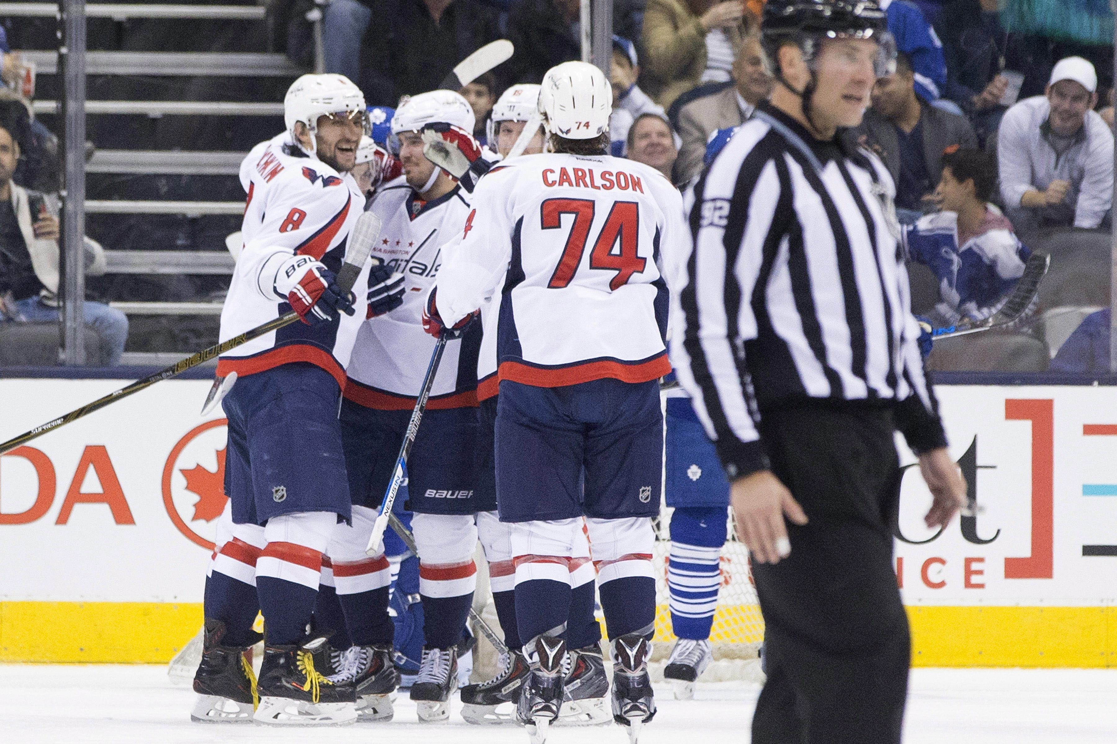 Washington Capitals' Alex Ovechkin (8) celebrates with teammates after scoring his team's third goal against the Toronto Maple Leafs during the second period of an NHL hockey game in Toronto, Saturday, Nov. 28, 2015. (Chris Young/The Canadian Press via AP