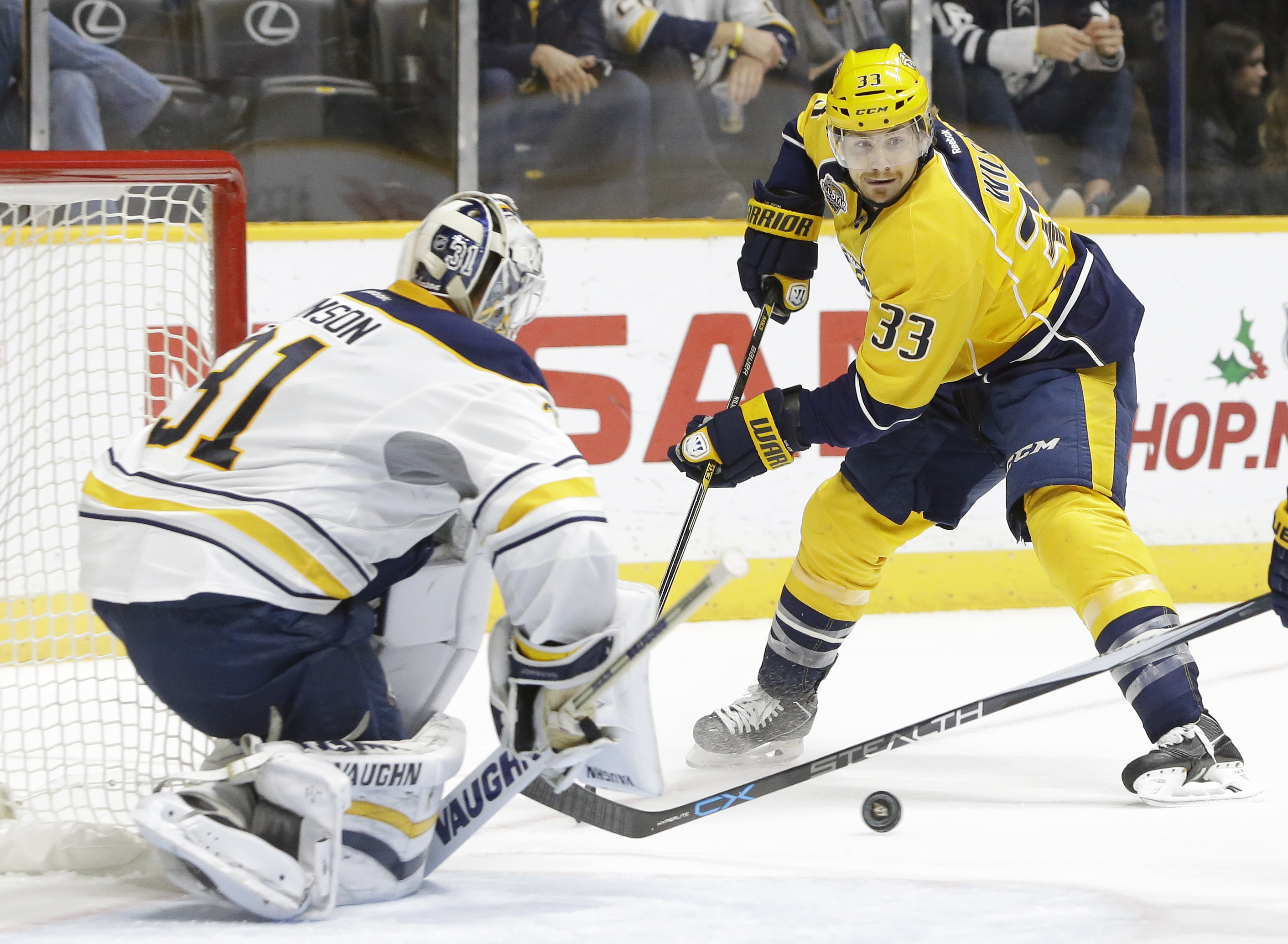 Buffalo Sabres goalie Chad Johnson (31) watches as Nashville Predators center Colin Wilson (33) closes in during the second period of an NHL hockey game Saturday, Nov. 28, 2015, in Nashville, Tenn. (AP Photo/Mark Humphrey)