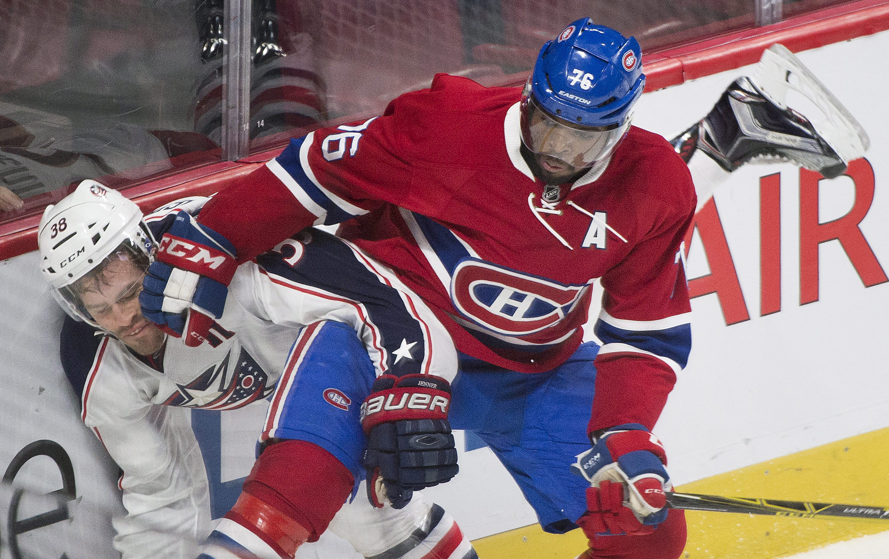 Columbus Blue Jackets' Boone Jenner (38) collides with Montreal Canadiens' P.K. Subban during second period NHL hockey action, Tuesday, Dec. 1, 2015 in Montreal. (Graham Hughes/The Canadian Press via AP)