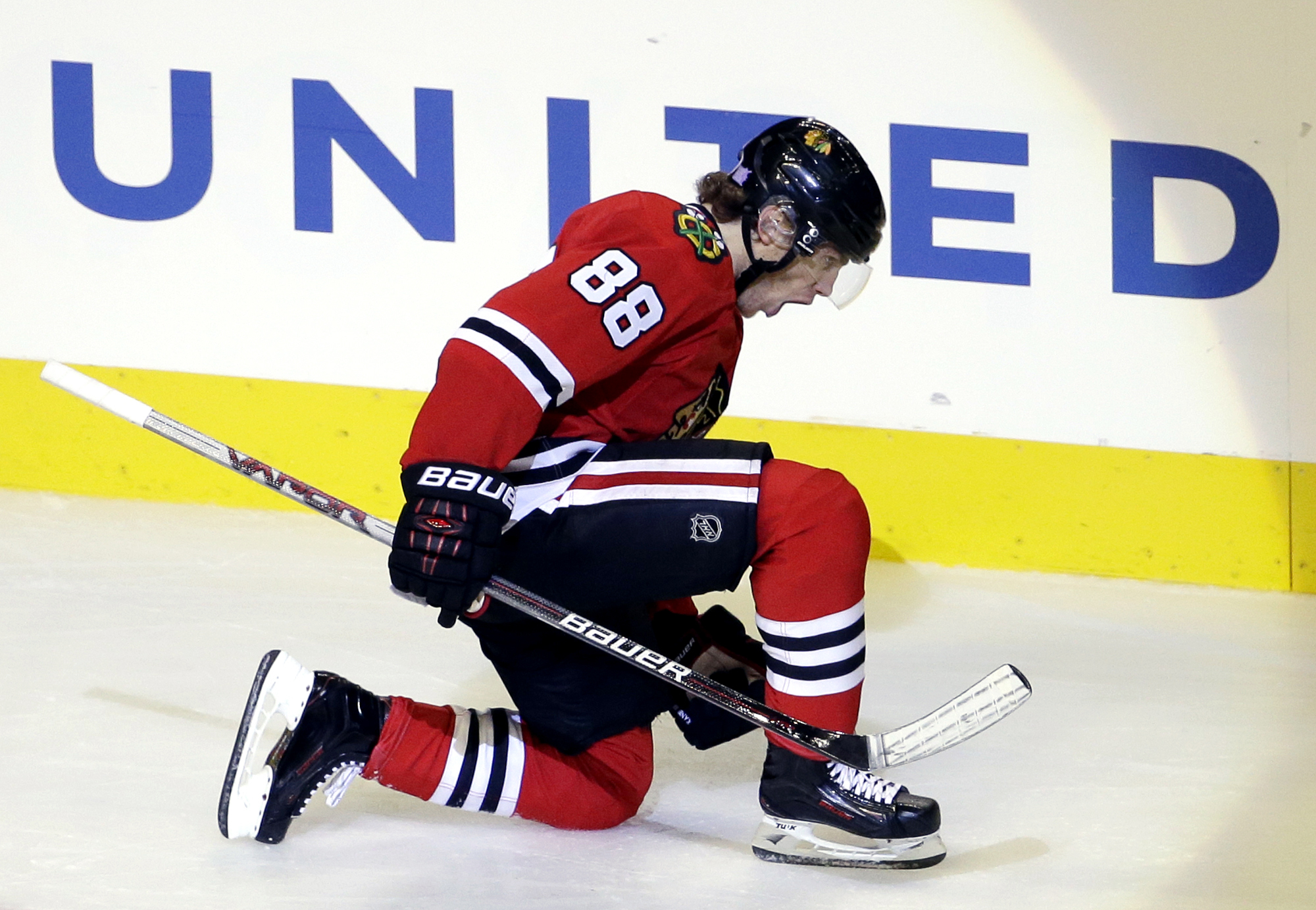 FILE - In this Nov. 8, 2015, file photo, Chicago Blackhawks right wing Patrick Kane celebrates after scoring his goal during the third period of an NHL hockey game against the Edmonton Oilers  in Chicago. Kane's second-period goal against Minnesota on Tue