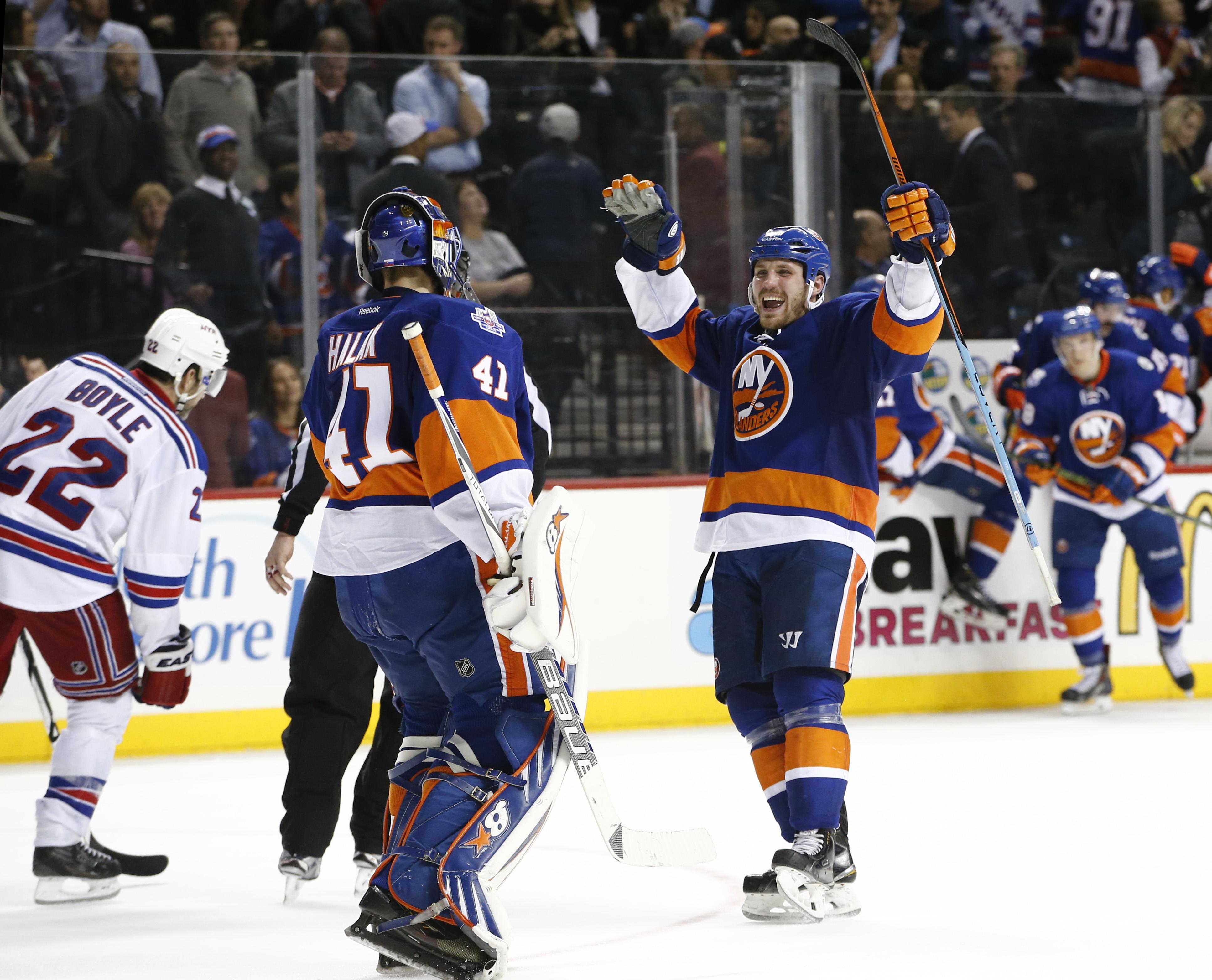 New York Rangers defenseman Dan Boyle (22) skates away as New York Islanders center Casey Cizikas (53) reacts after the Islanders defeated the New York Rangers 2-1 in a shootout in an NHL hockey game at the Barclays Center in New York, Wednesday, Dec. 2,