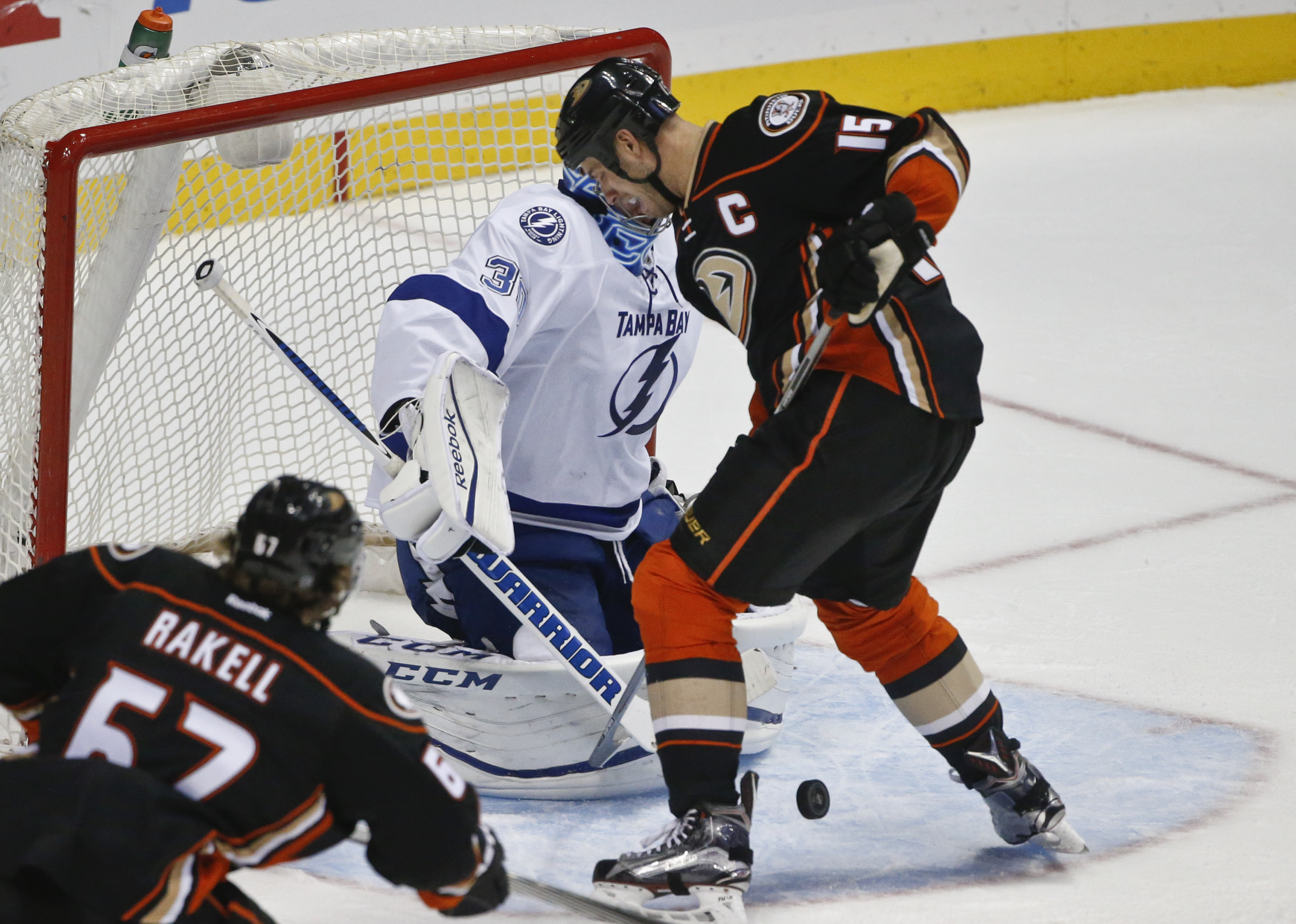 Anaheim Ducks center Ryan Getzlaf tries to get his stick on the puck while standing in the Tampa Bay Lightning crease with goalie Ben Bishop during the second period of a NHL hockey game Wednesday, Dec. 2, 2015, in Anaheim, Calif.  (AP Photo/Lenny Ignelzi
