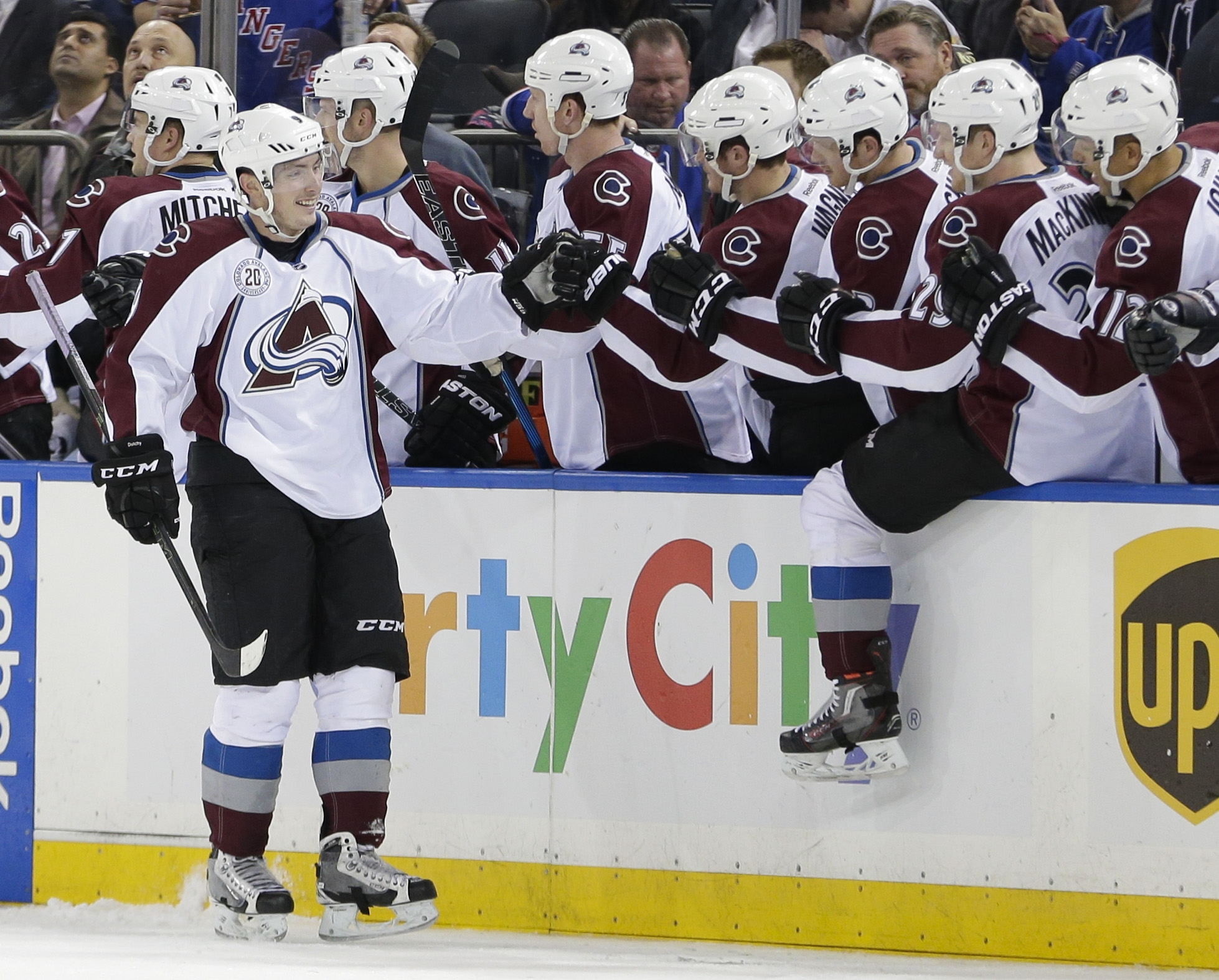 Colorado Avalanche's Matt Duchene (9) celebrates with teammates after scoring a goal during the second period of an NHL hockey game against the New York Rangers Thursday, Dec. 3, 2015, in New York. (AP Photo/Frank Franklin II)