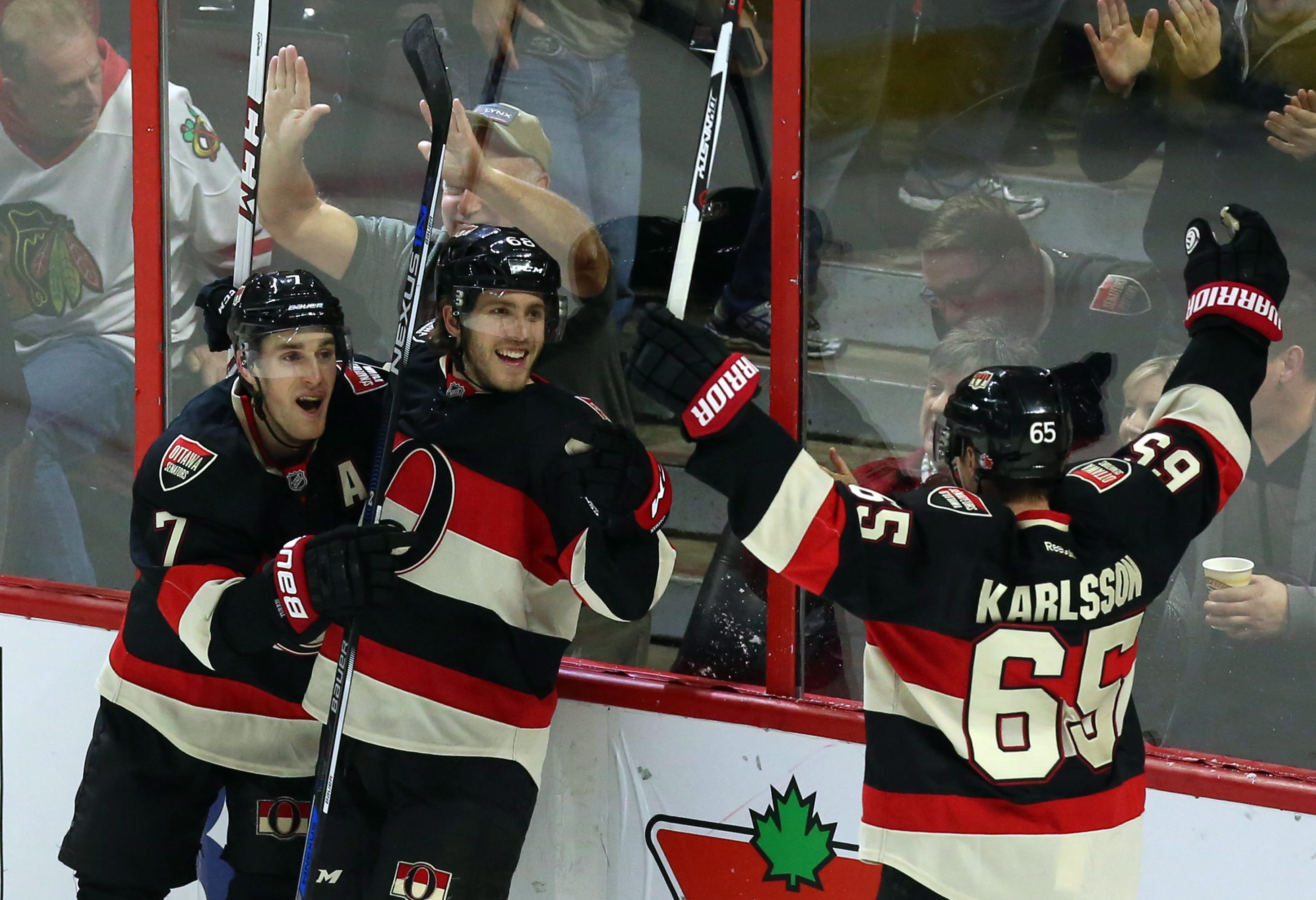 Ottawa Senators' Mike Hoffman (68) celebrates his game winning overtime goal against the Chicago Blackhawks with teammates Erik Karlsson (65) and Kyle Turris (7) during an NHL hockey game in Ottawa, Ontario, Thursday, Dec. 3, 2015. (Fred Chartrand/The Can