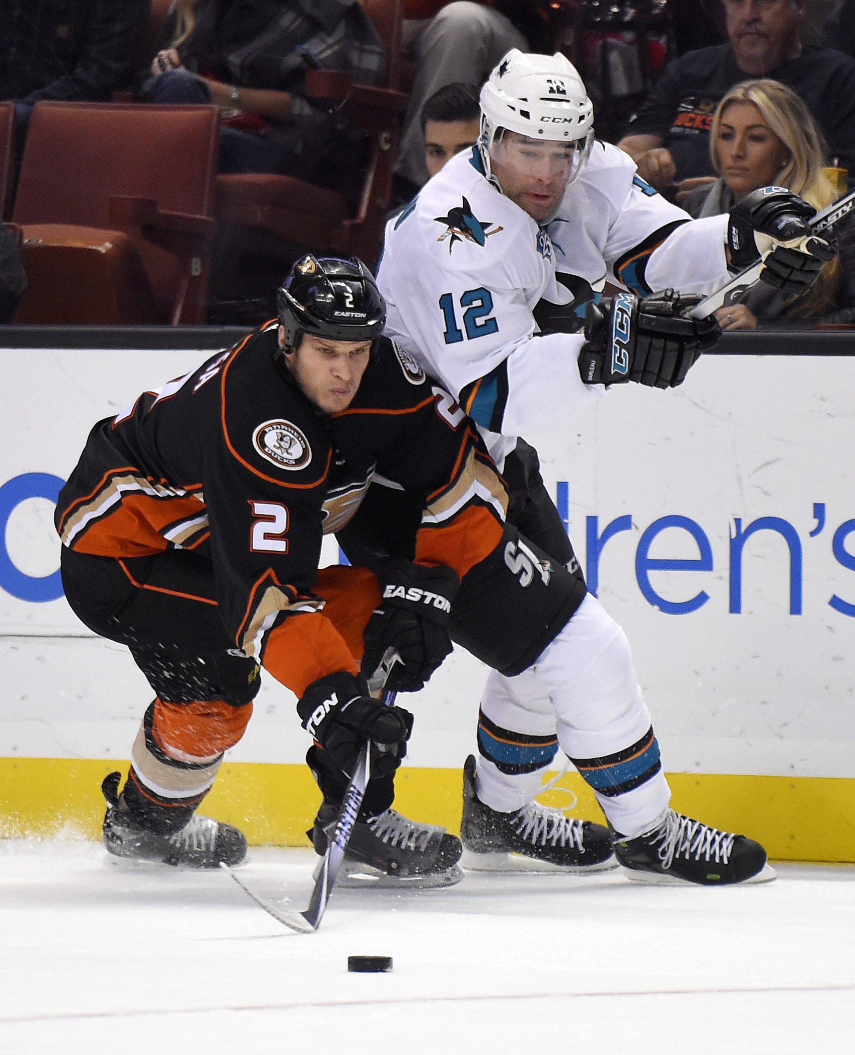 Anaheim Ducks defenseman Kevin Bieksa, left, and San Jose Sharks center Patrick Marleau vie for the puck during the first period of an NHL hockey game, Friday, Dec. 4, 2015, in Anaheim, Calif. (AP Photo/Mark J. Terrill)