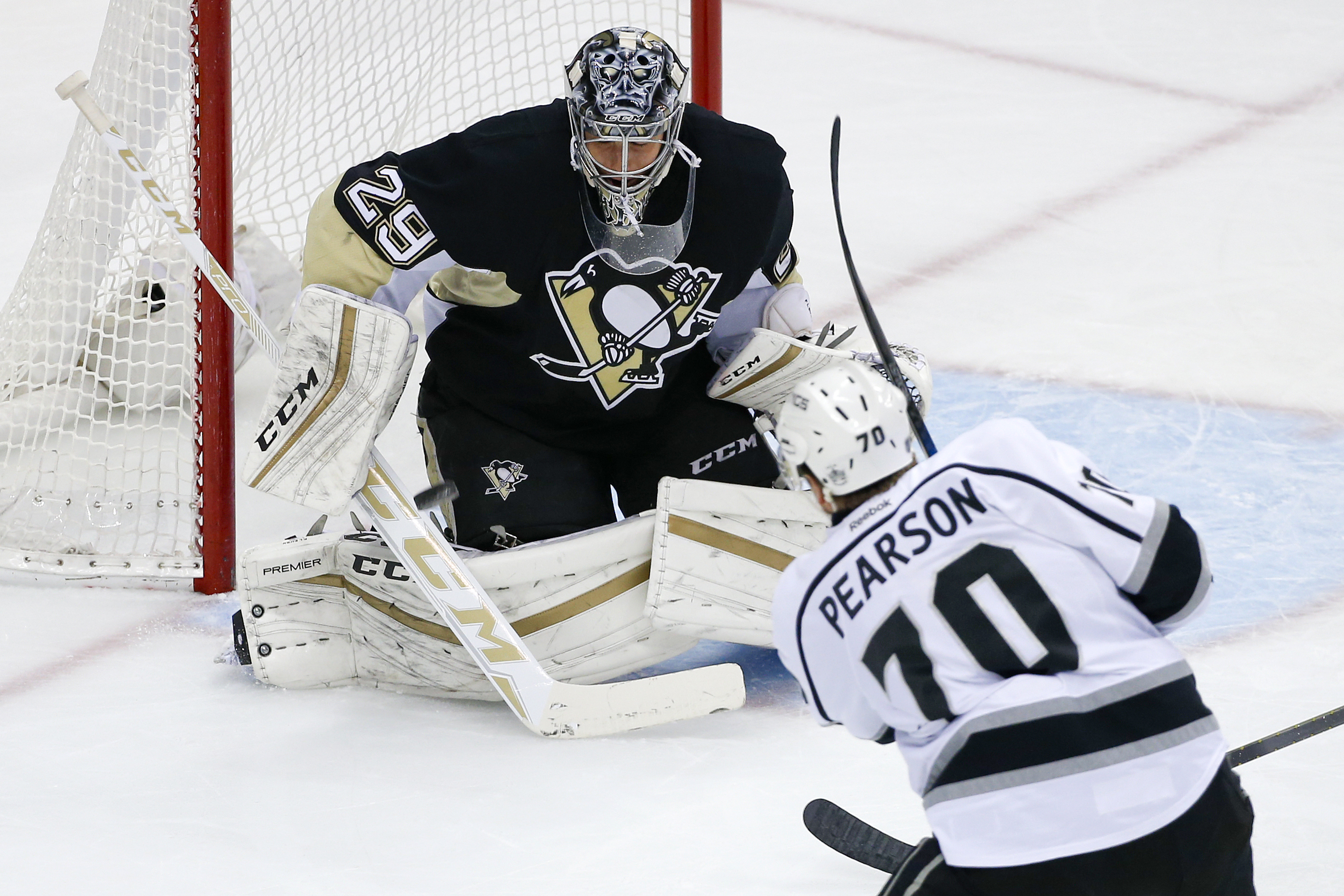 Los Angeles Kings' Tanner Pearson (70) fires a shot past Pittsburgh Penguins goalie Marc-Andre Fleury (29) for a goal during the first period of an NHL hockey game in Pittsburgh, Friday, Dec. 11, 2015. (AP Photo/Gene J. Puskar)