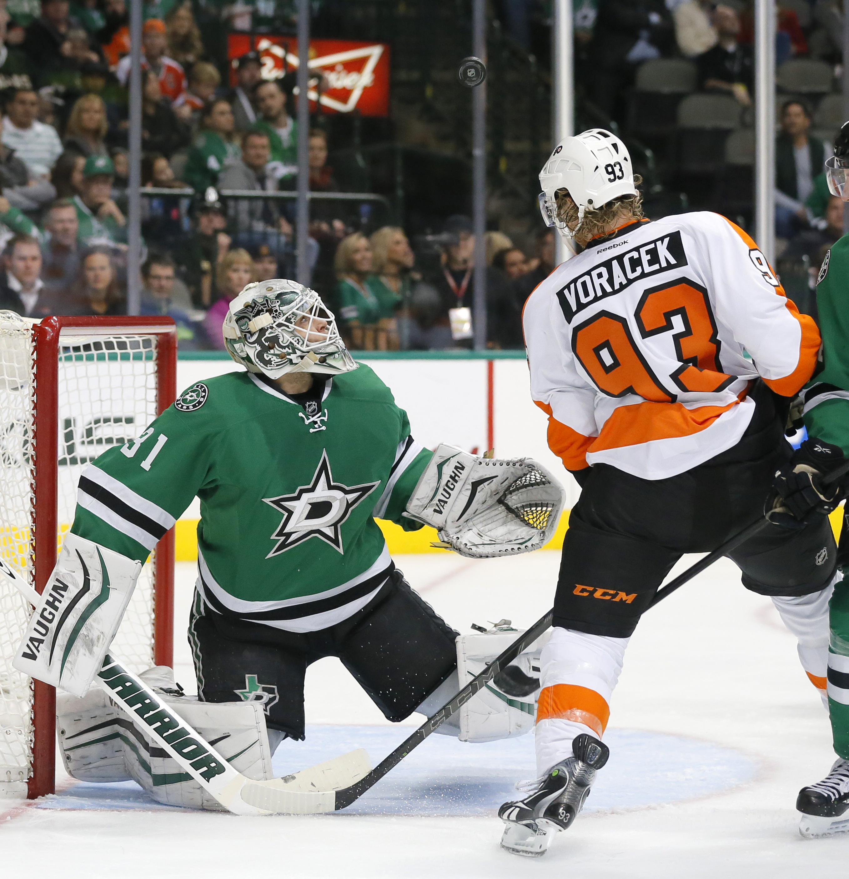 Dallas Stars goalie Antti Niemi (31), of Finland, watches the airborne puck after a shot by Philadelphia Flyers right wing Jakub Voracek (93), of the Czech Republic, in the second period of an NHL hockey game, Friday, Dec. 11, 2015, in Dallas. (AP Photo/T