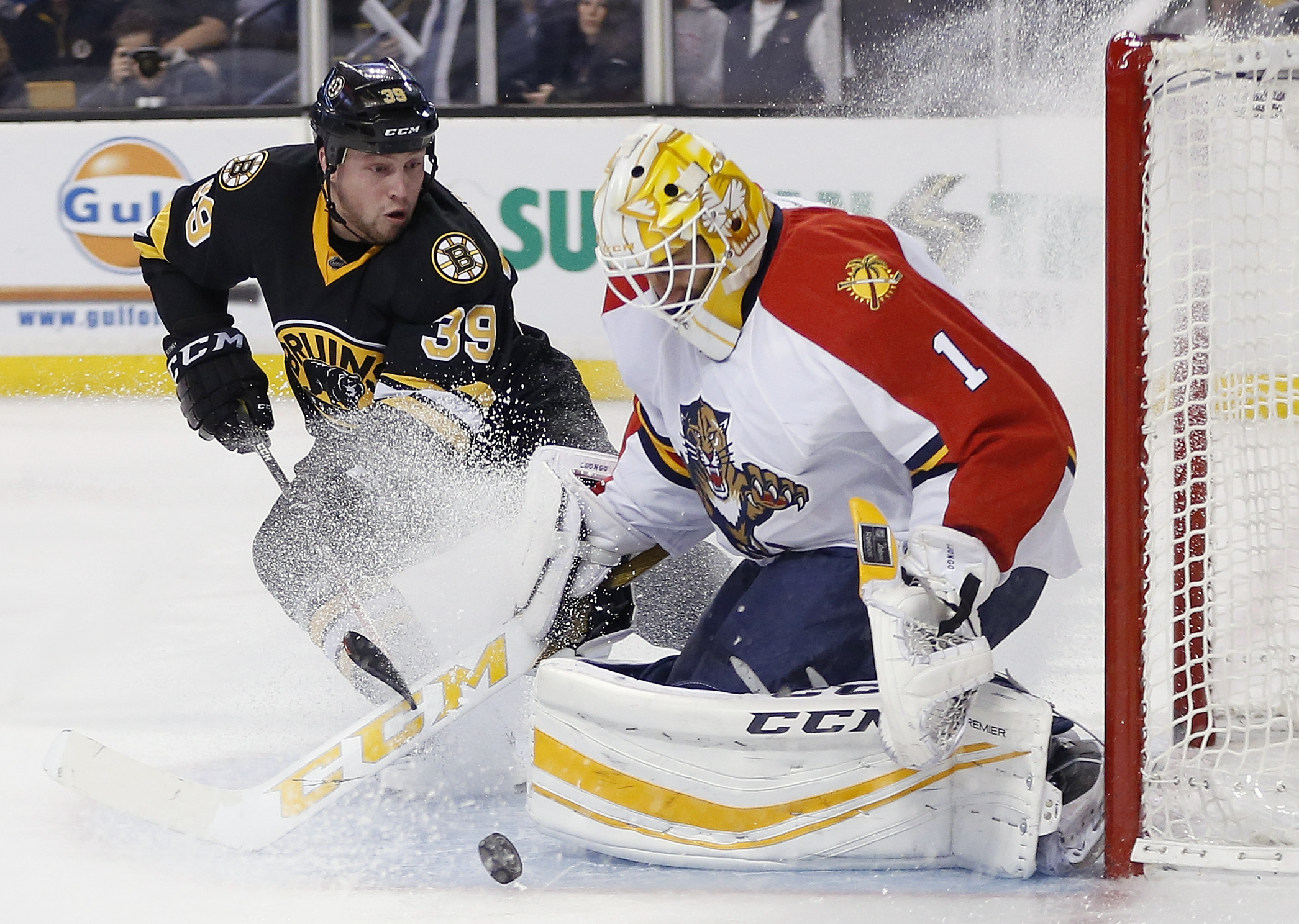 Boston Bruins' Matt Beleskey (39) looks for the rebound off Florida Panthers' Roberto Luongo (1) during the second period of an NHL hockey game in Boston, Saturday, Dec. 12, 2015. (AP Photo/Michael Dwyer)