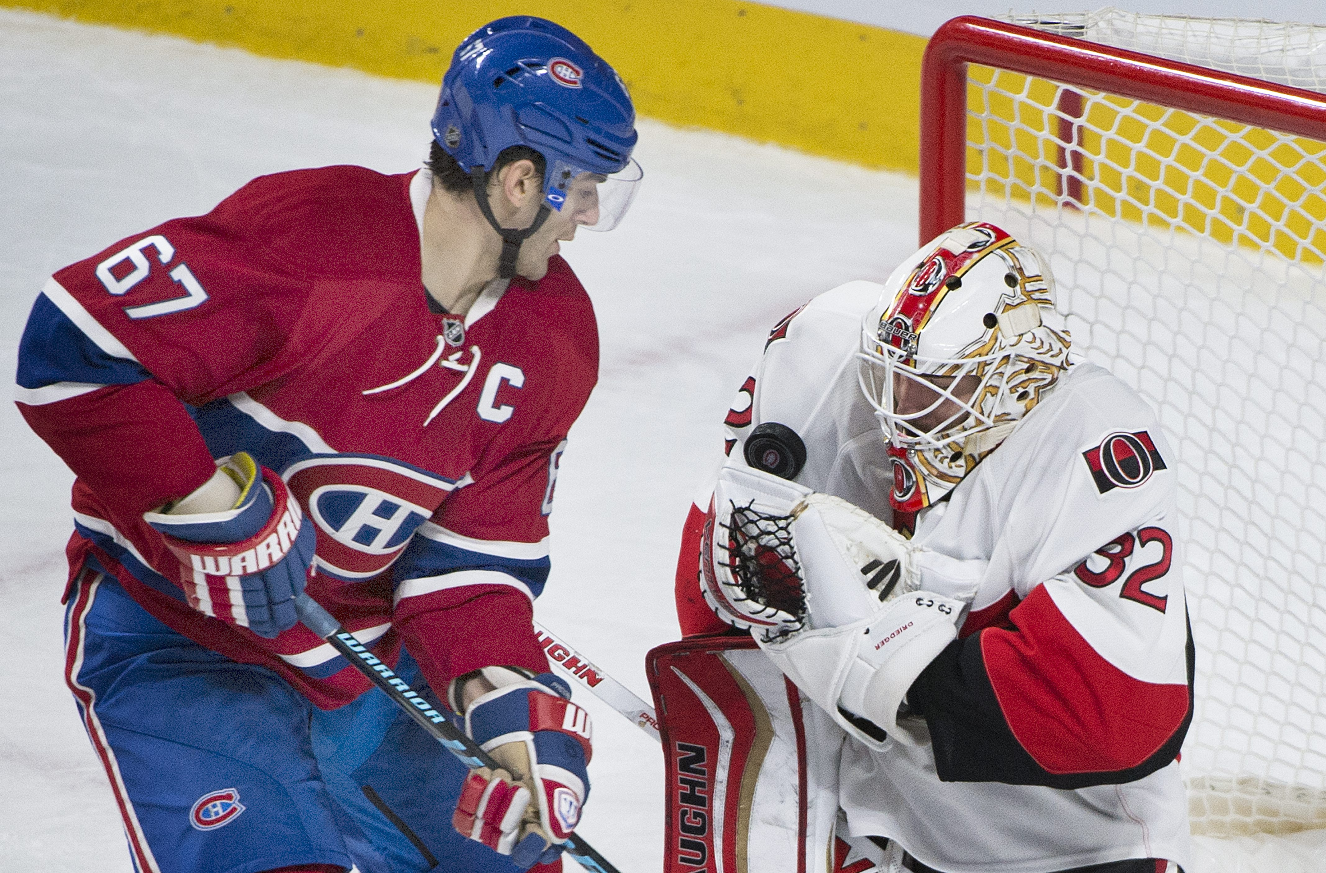 Montreal Canadiens' captain Max Pacioretty moves in on Ottawa Senators' goalie Chris Driedger during second period NHL hockey action, in Montreal, on Saturday, Dec. 12, 2015. (Graham Hughes/The Canadian Press via AP)
