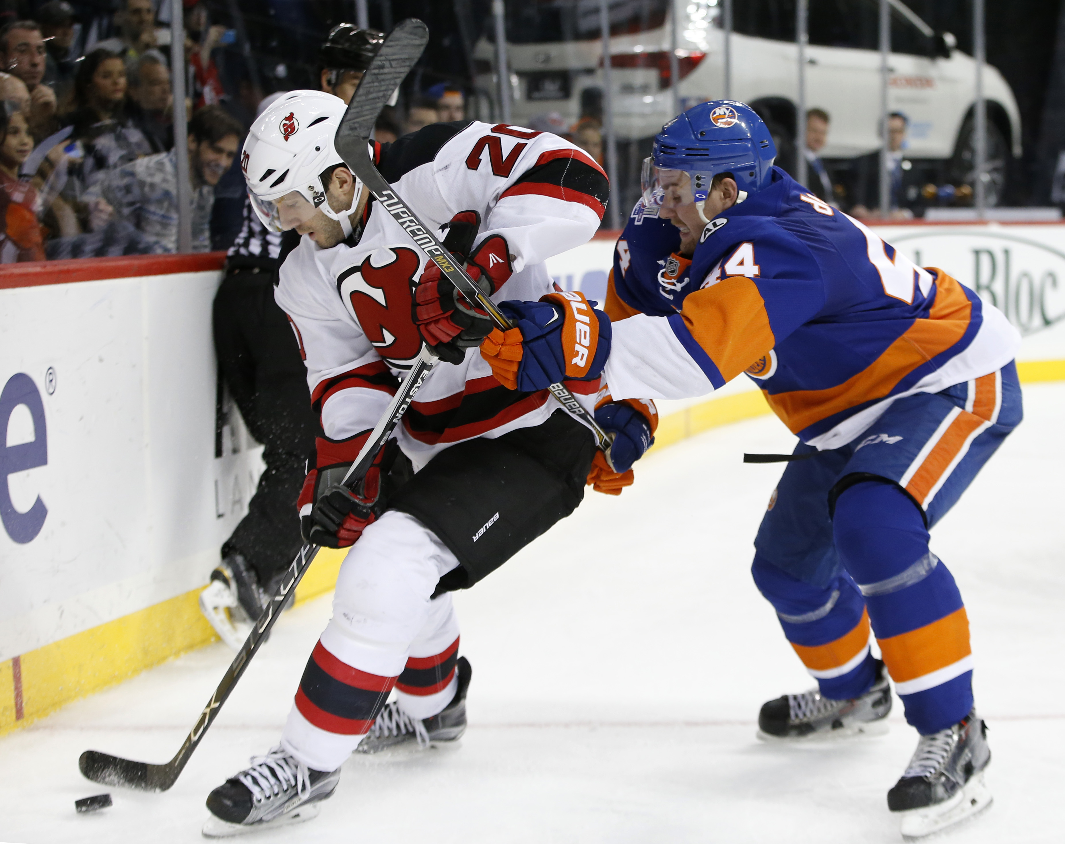 New York Islanders defenseman Calvin de Haan (44) defends against New Jersey Devils right wing Lee Stempniak (20) in the third period of an NHL hockey game in New York, Sunday, Dec. 13, 2015.  The Islanders shut out the Devils 4-0. (AP Photo/Kathy Willens