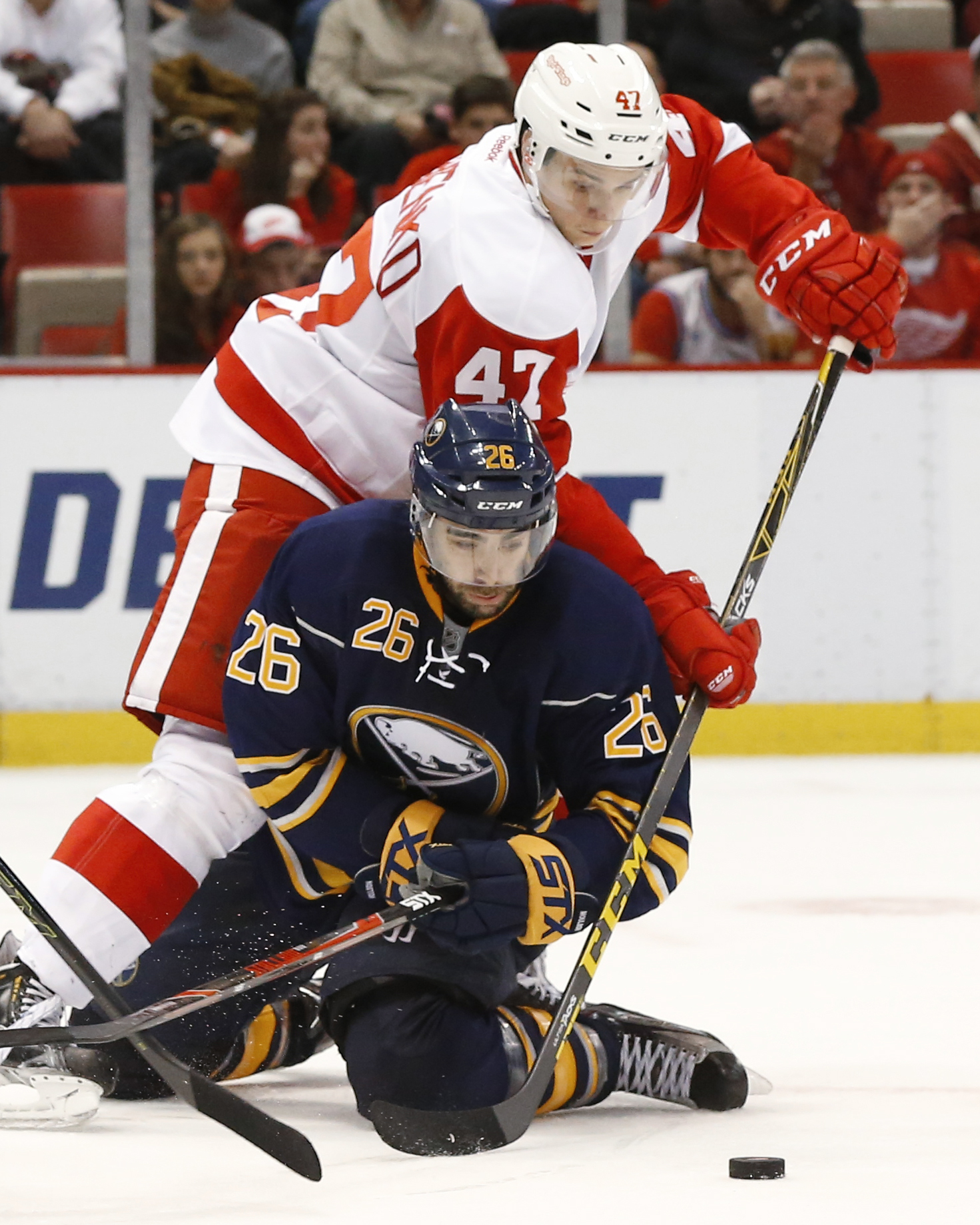 Buffalo Sabres left wing Matt Moulson (26) tries to shoot as Detroit Red Wings defenseman Alexei Marchenko (47) defends in the third period of an NHL hockey game Monday, Dec. 14, 2015 in Detroit. (AP Photo/Paul Sancya)