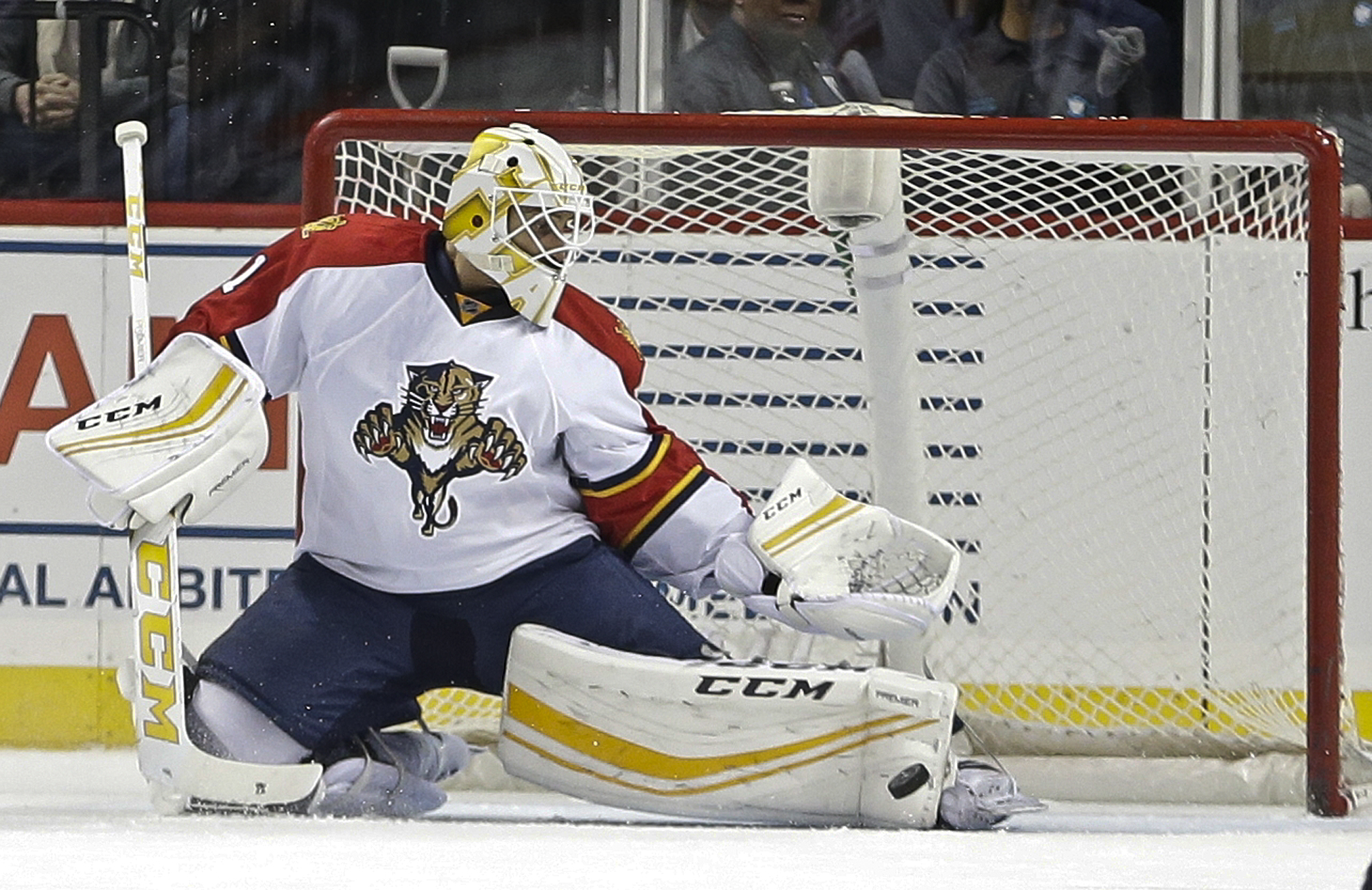 Florida Panthers goalie Roberto Luongo stops a shot during the first period of an NHL hockey game against the New York Islanders on Tuesday, Dec. 15, 2015, in New York. (AP Photo/Frank Franklin II)