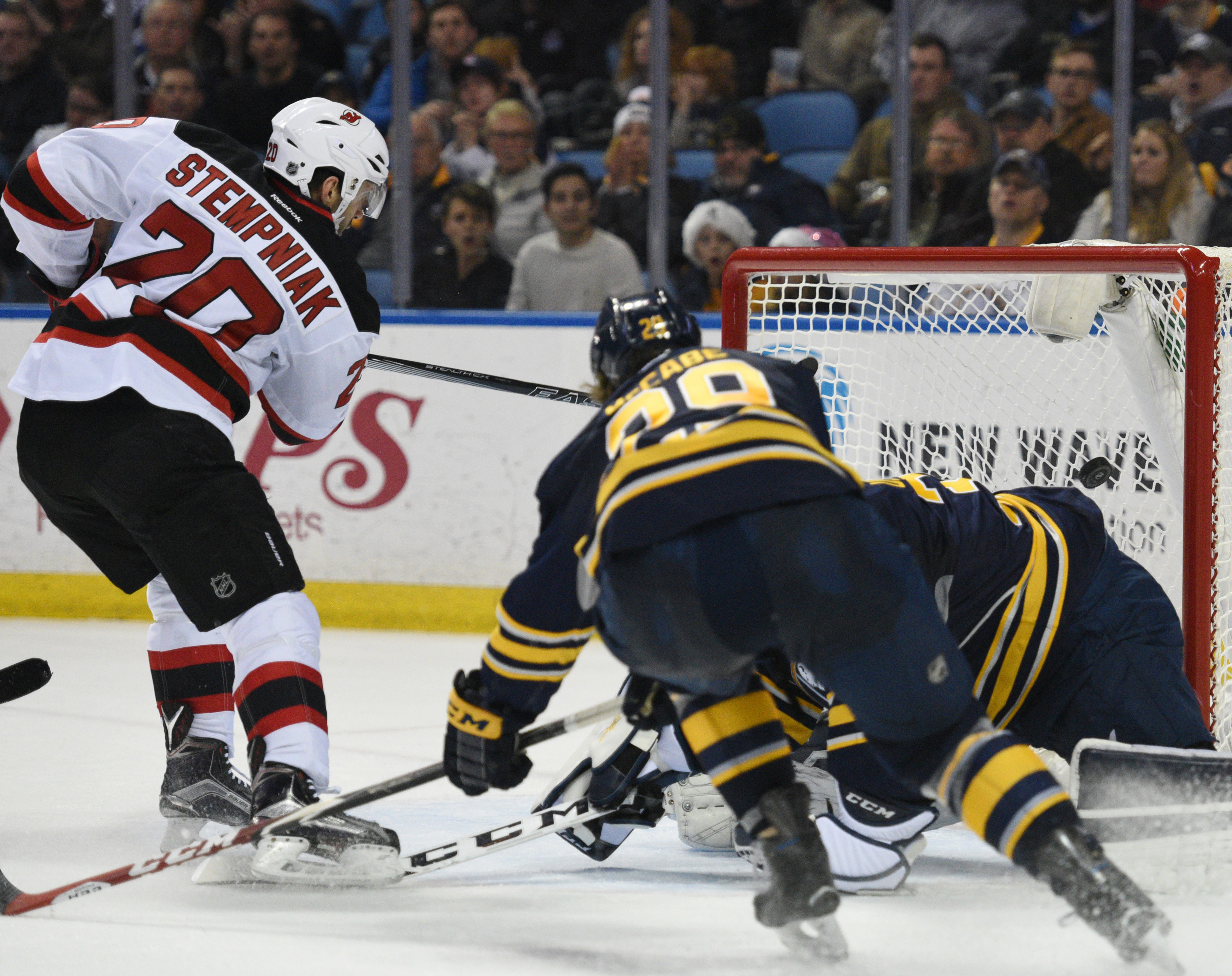 New Jersey Devils right winger Lee Stempniak (20) scores as Sabres goaltender Linus Ullmark, of Sweden, and defenseman Brian McCabe defend during the second period of an NHL hockey game, Tuesday Dec. 15, 2015 in Buffalo, N.Y. (AP Photo/Gary Wiepert)
