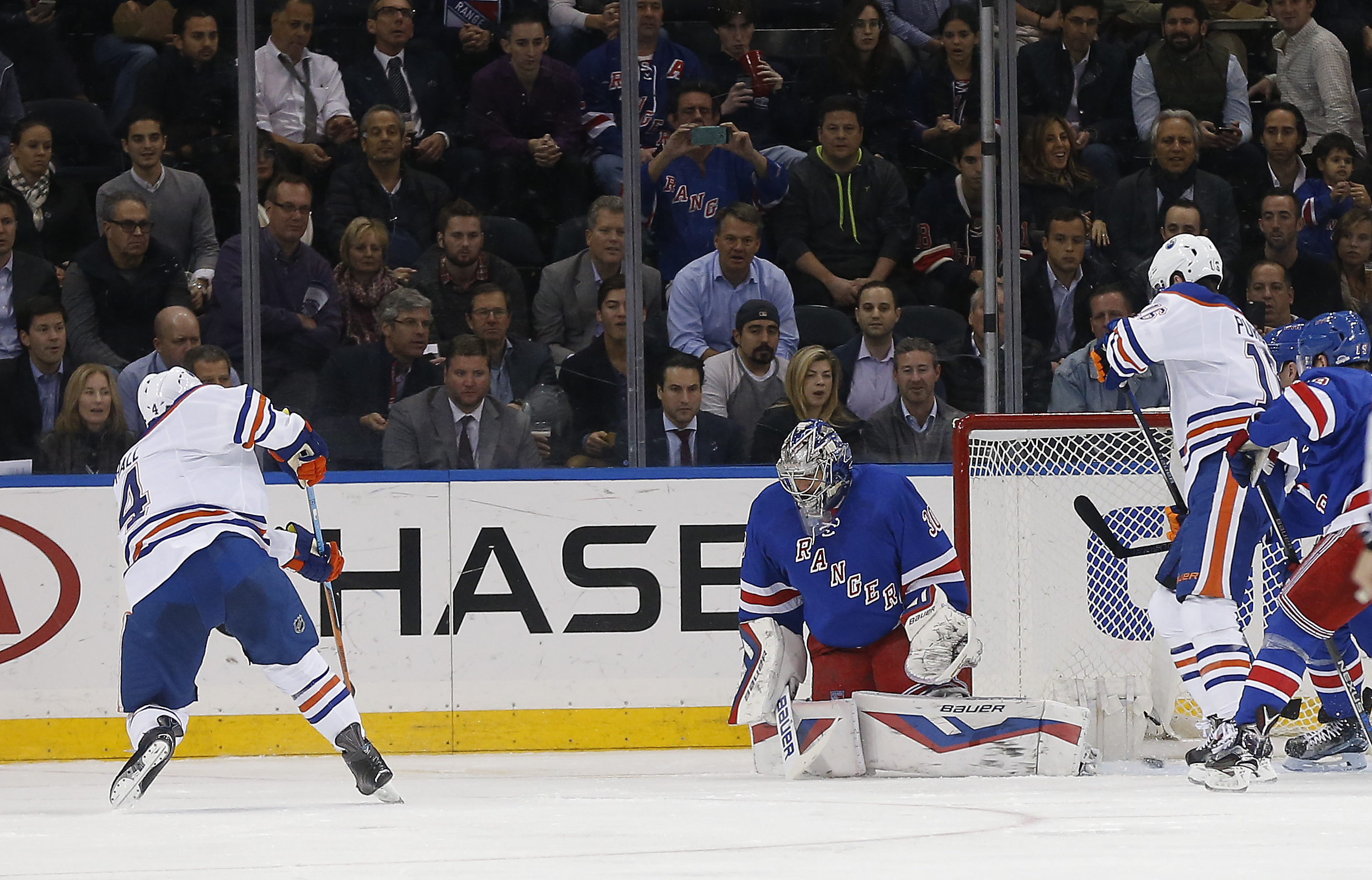Edmonton Oilers left wing Taylor Hall (4) shoots and scores against the New York Rangers goalie Henrik Lundqvist (30) during the second period of an NHL hockey game, Tuesday, Dec. 15, 2015, in New York. (AP Photo/Julie Jacobson)