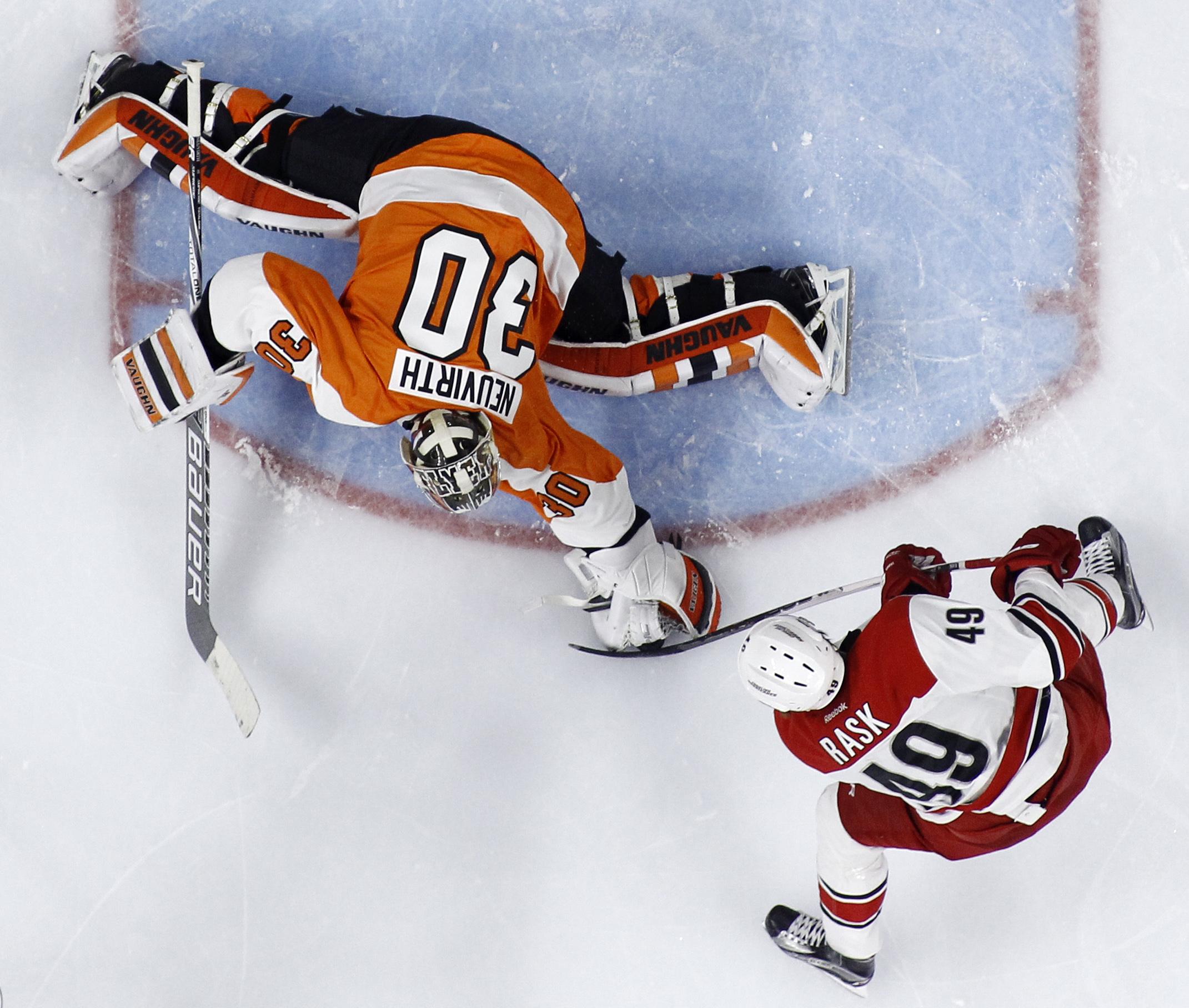 Philadelphia Flyers' Michal Neuvirth (30) blocks a shot by Carolina Hurricanes' Victor Rask (49) during the third period of an NHL hockey game Tuesday, Dec. 15, 2015, in Philadelphia. Philadelphia won 4-3 in overtime. (AP Photo/Matt Slocum)