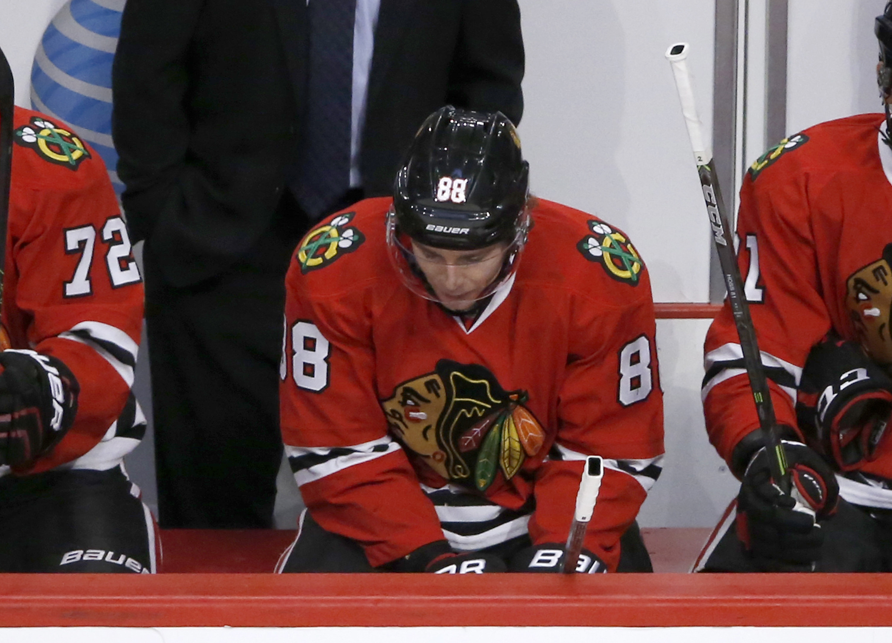 Chicago Blackhawks right wing Patrick Kane looks down on the bench during the closing minutes of the third period of an NHL hockey game against the Colorado Avalanche Tuesday, Dec. 15, 2015, in Chicago. The Avalanche won 3-0. Kane's consecutive points str