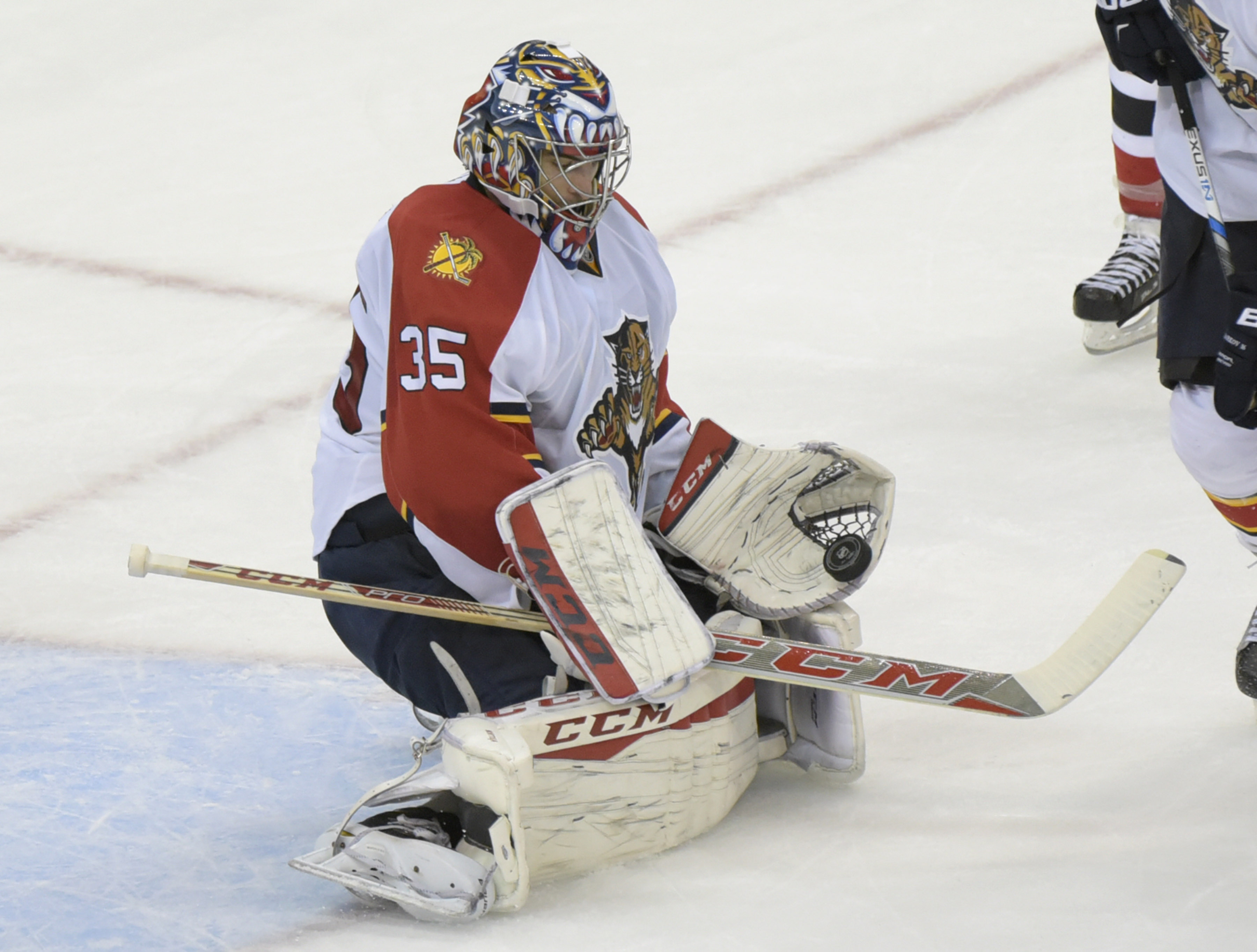 Florida Panthers goaltender Al Montoya attempts to glove the puck during the second period of an NHL hockey game against the New Jersey Devils on Thursday, Dec. 17, 2015, in Newark, N.J. (AP Photo/Bill Kostroun)