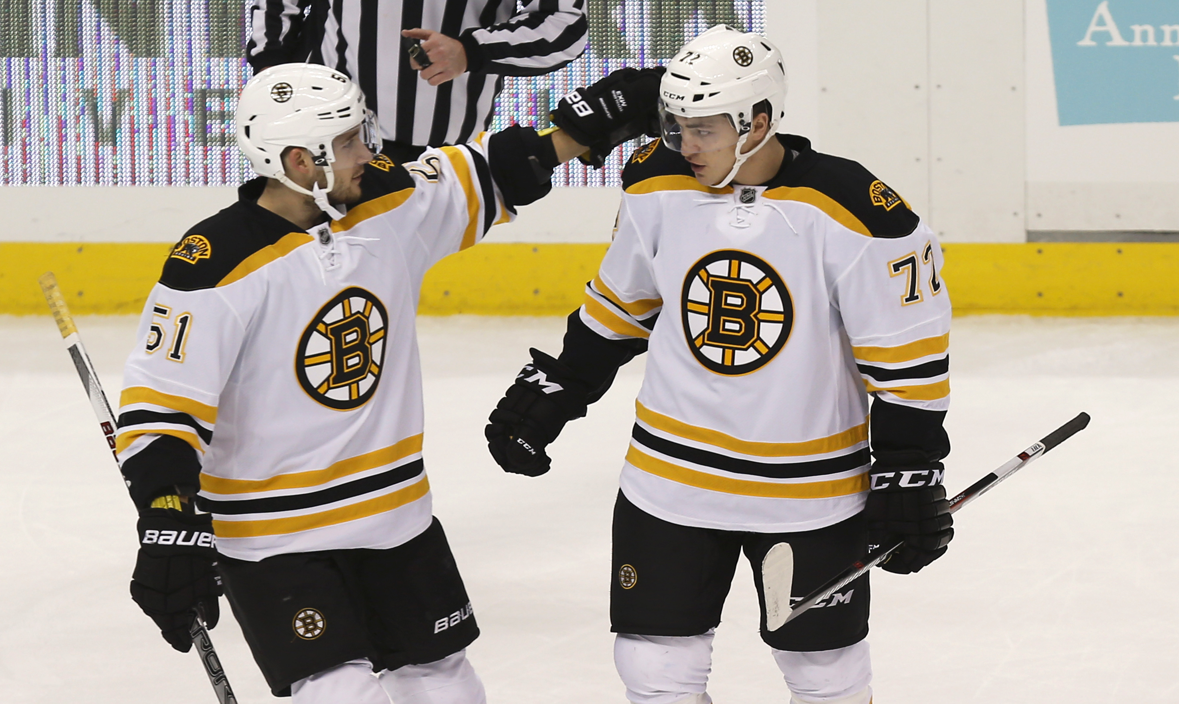 Boston Bruins' Frank Vatrano (72) is congratulated by Ryan Spooner (51) after scoring against the Pittsburgh Penguins during the first period of an NHL hockey game Friday, Dec. 18, 2015, in Pittsburgh. (AP Photo/Keith Srakocic)