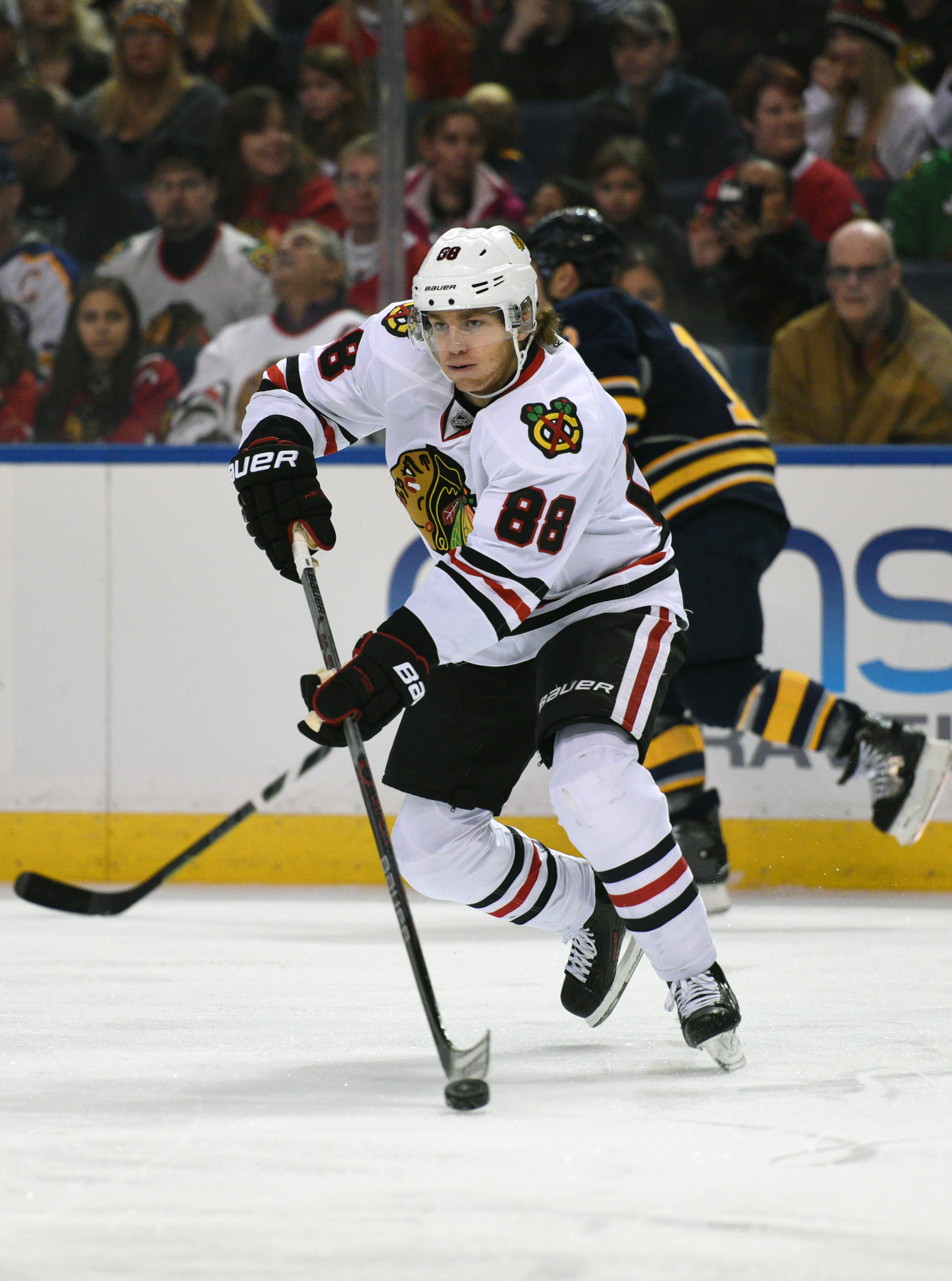 Chicago Blackhawks right winger Patrick Kane (88) skates up ice during the first period of an NHL hockey game against the Buffalo Sabres, Saturday Dec. 19, 2015 in Buffalo, N.Y. (AP Photo/Gary Wiepert)