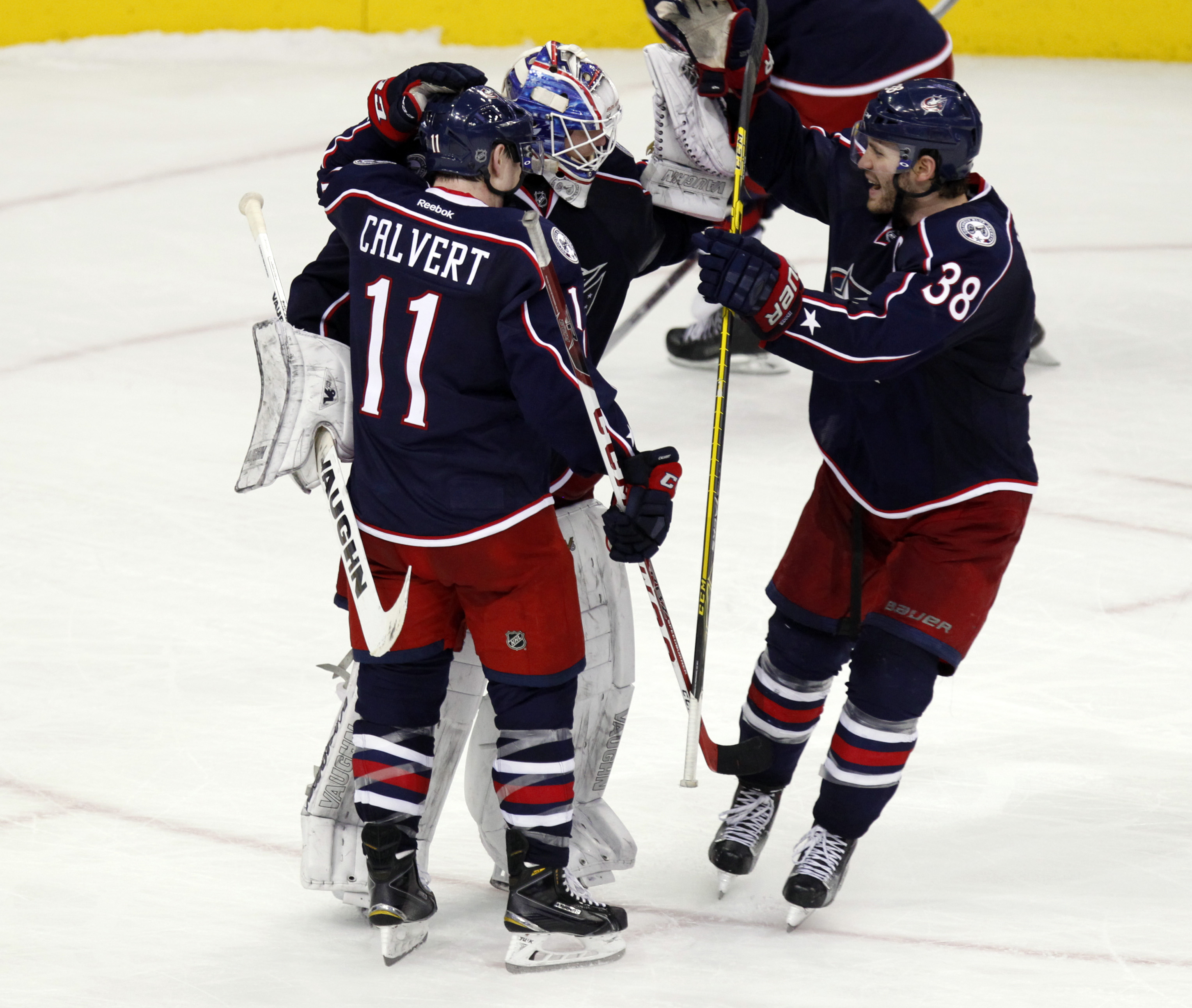 Columbus Blue Jackets' Matt Calvert, left, goalie Joonas Korpisalo, of Finland, and Boone Jenner celebrate after Korpisalo stopped a shot by Philadelphia Flyers' Brayden Schenn in a shoot out during an NHL hockey game in Columbus, Ohio, Saturday, Dec. 19,