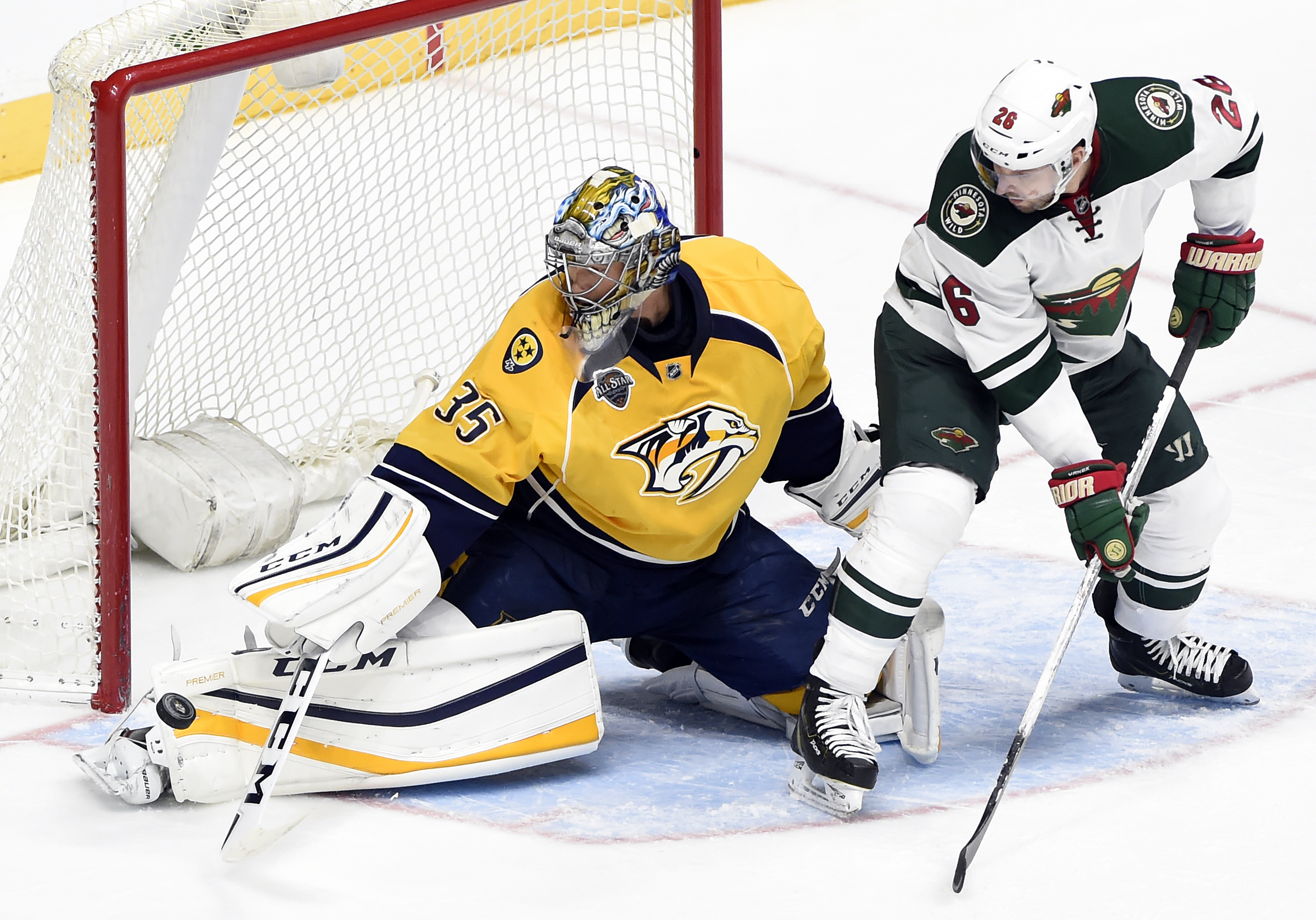 Minnesota Wild left wing Thomas Vanek (26), of Austria, watches the puck bounce past Nashville Predators goalie Pekka Rinne (35), of Finland, in the third period of an NHL hockey game Saturday, Dec. 19, 2015, in Nashville, Tenn. The Predators won 3-2. (AP