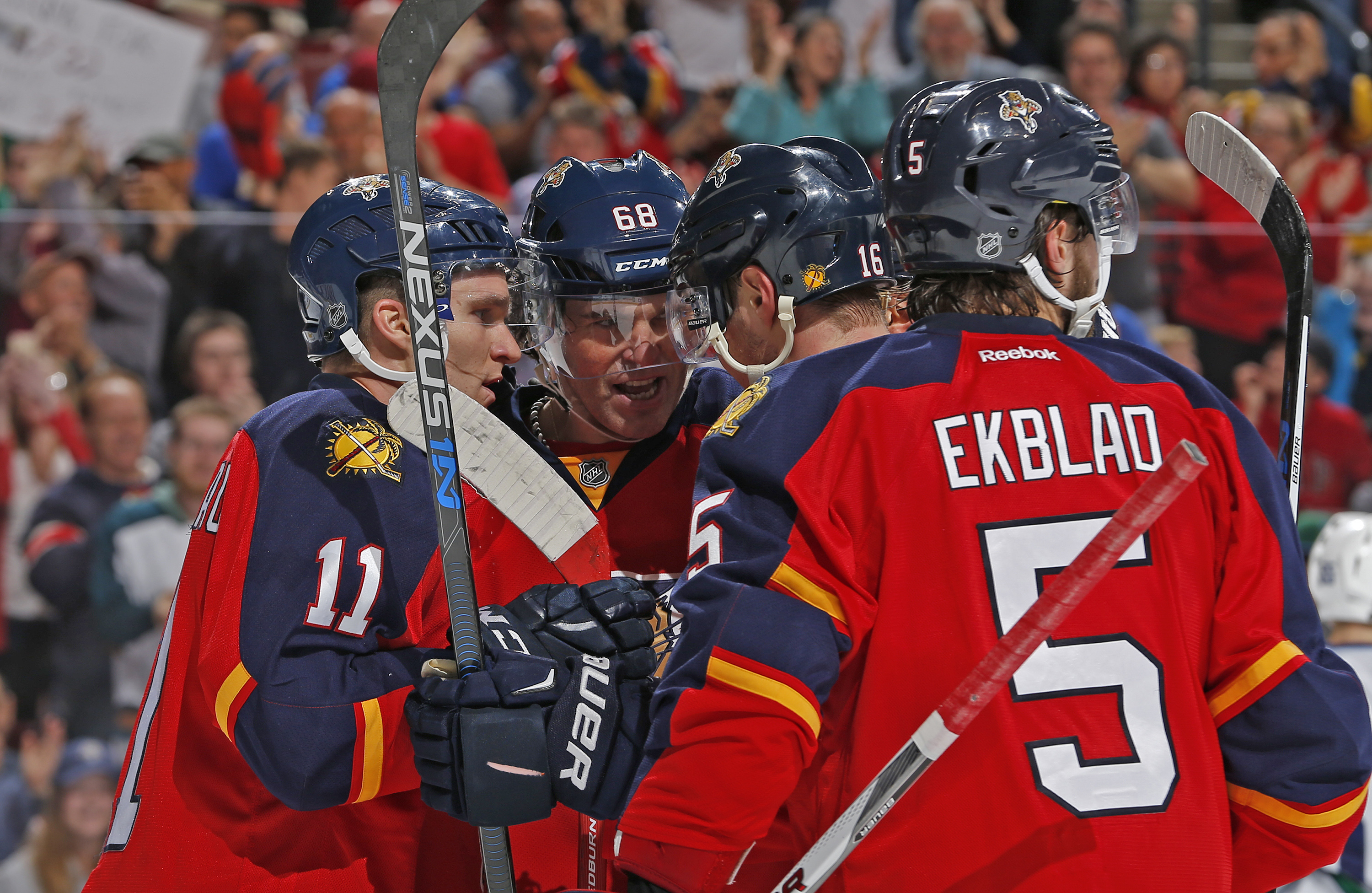 Florida Panthers forward Jaromir Jagr (68) is congratulated by forward Aleksander Barkov (16) and forward Jonathan Huberdeau (11) after scoring the go-ahead goal during the first period of an NHL hockey game against the Vancouver Canucks, Sunday, Dec. 20,