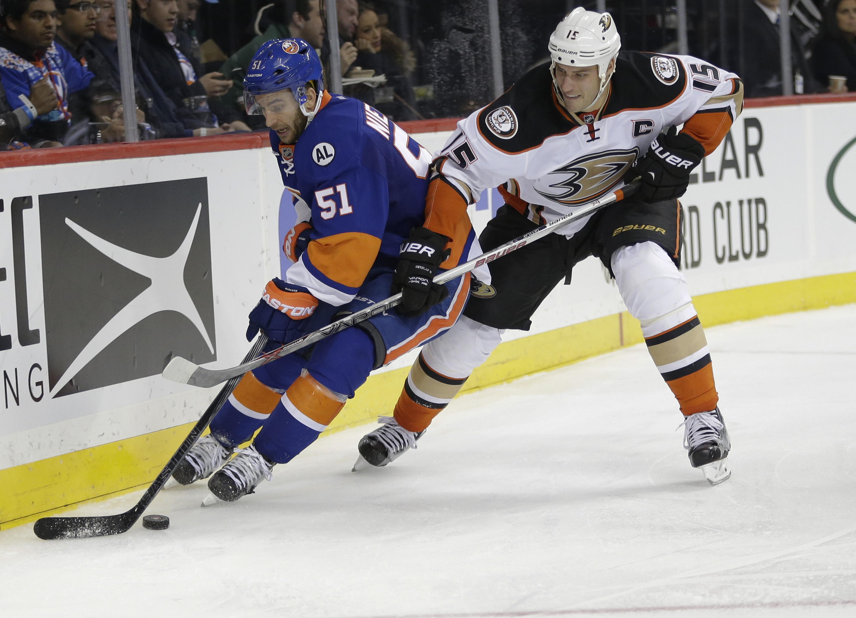 New York Islanders' Frans Nielsen (51) and Anaheim Ducks' Ryan Getzlaf (15) fight for control of the puck during the second period of an NHL hockey game Monday, Dec. 21, 2015, in New York. (AP Photo/Frank Franklin II)
