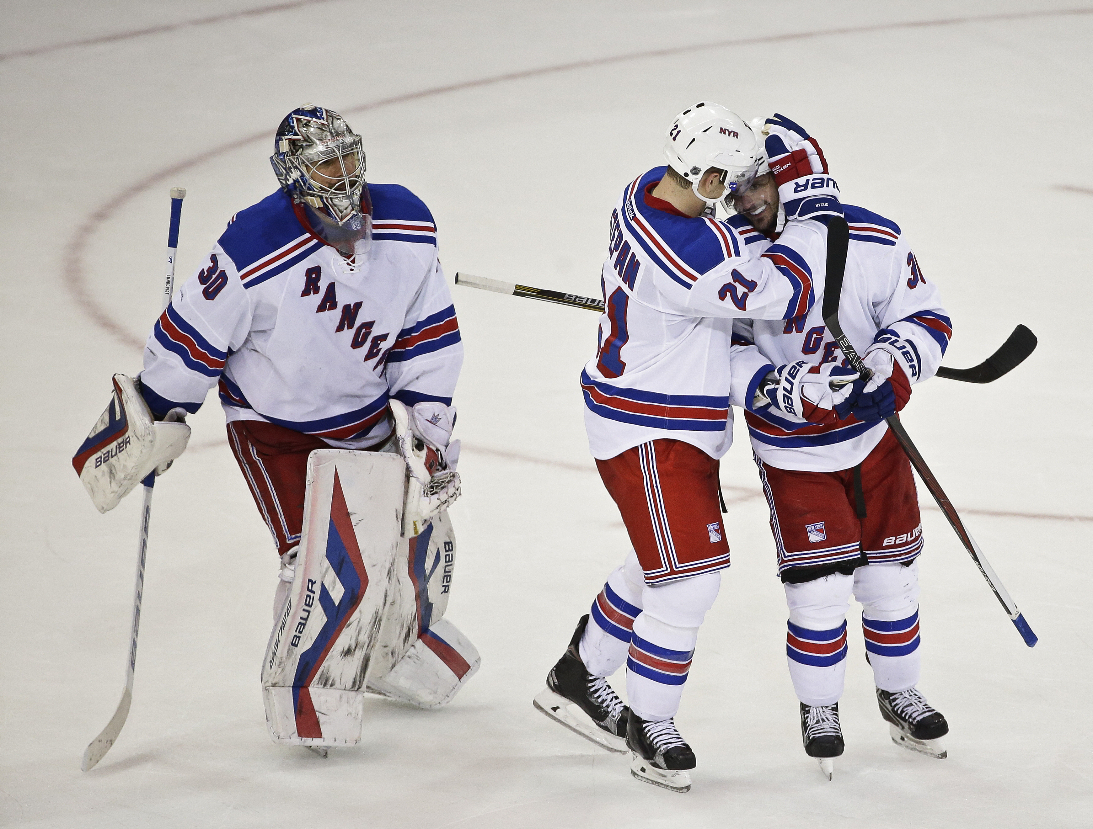 New York Rangers goalie Henrik Lundqvist (30) and Derek Stepan (21) celebrate with Mats Zuccarello (36) after Zuccarello scored a goal during overtime in an NHL hockey game against the Anaheim Ducks on Tuesday, Dec. 22, 2015, in New York. The Rangers won