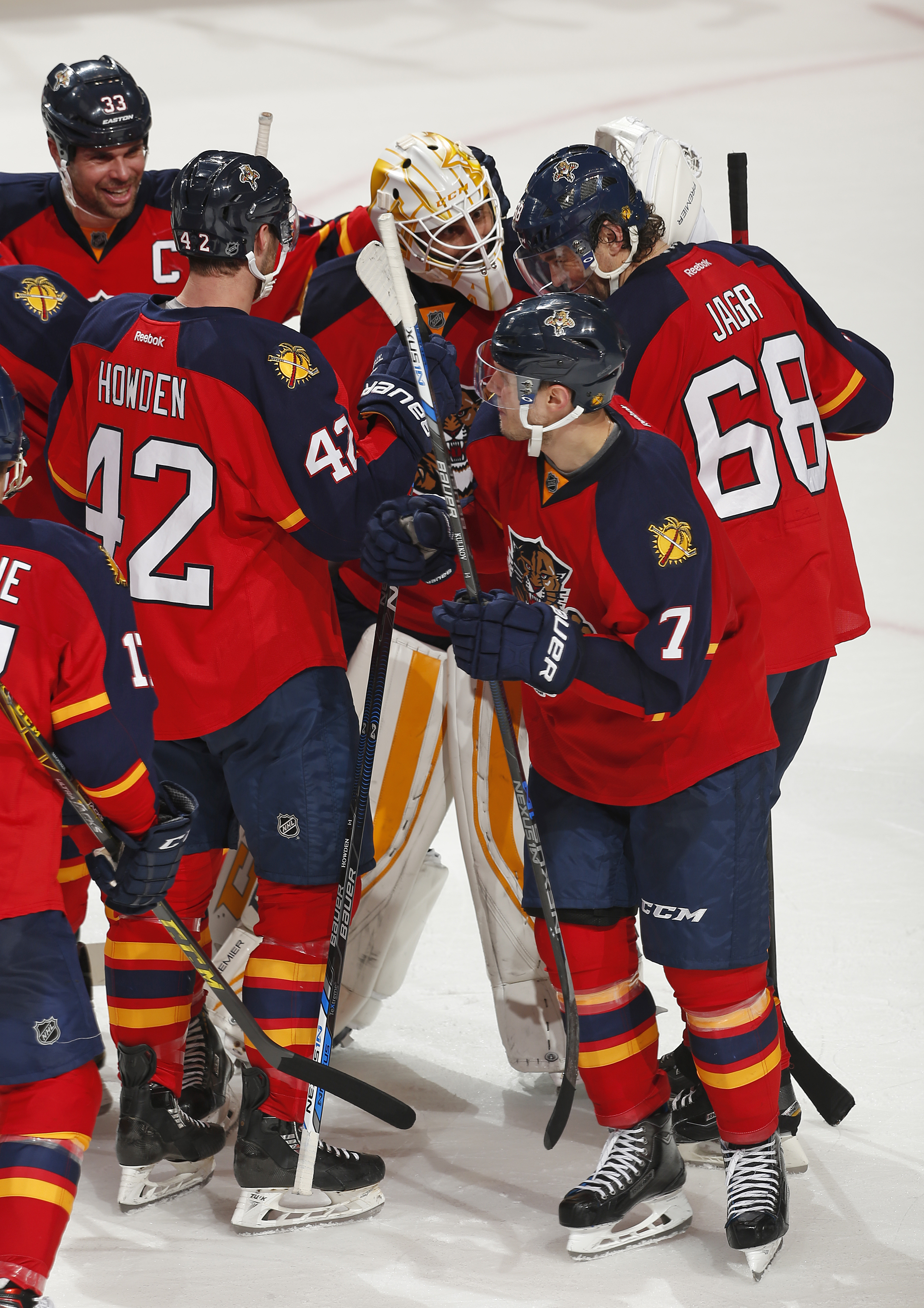 Florida Panthers goaltender Roberto Luongo (1) is congratulated by forward Jaromir Jagr (68), forward Quentin Howden (42), and defenseman Willie Mitchell (33) at the conclusion of the shoot-out of an NHL hockey game against the Ottawa Senators, Tuesday, D