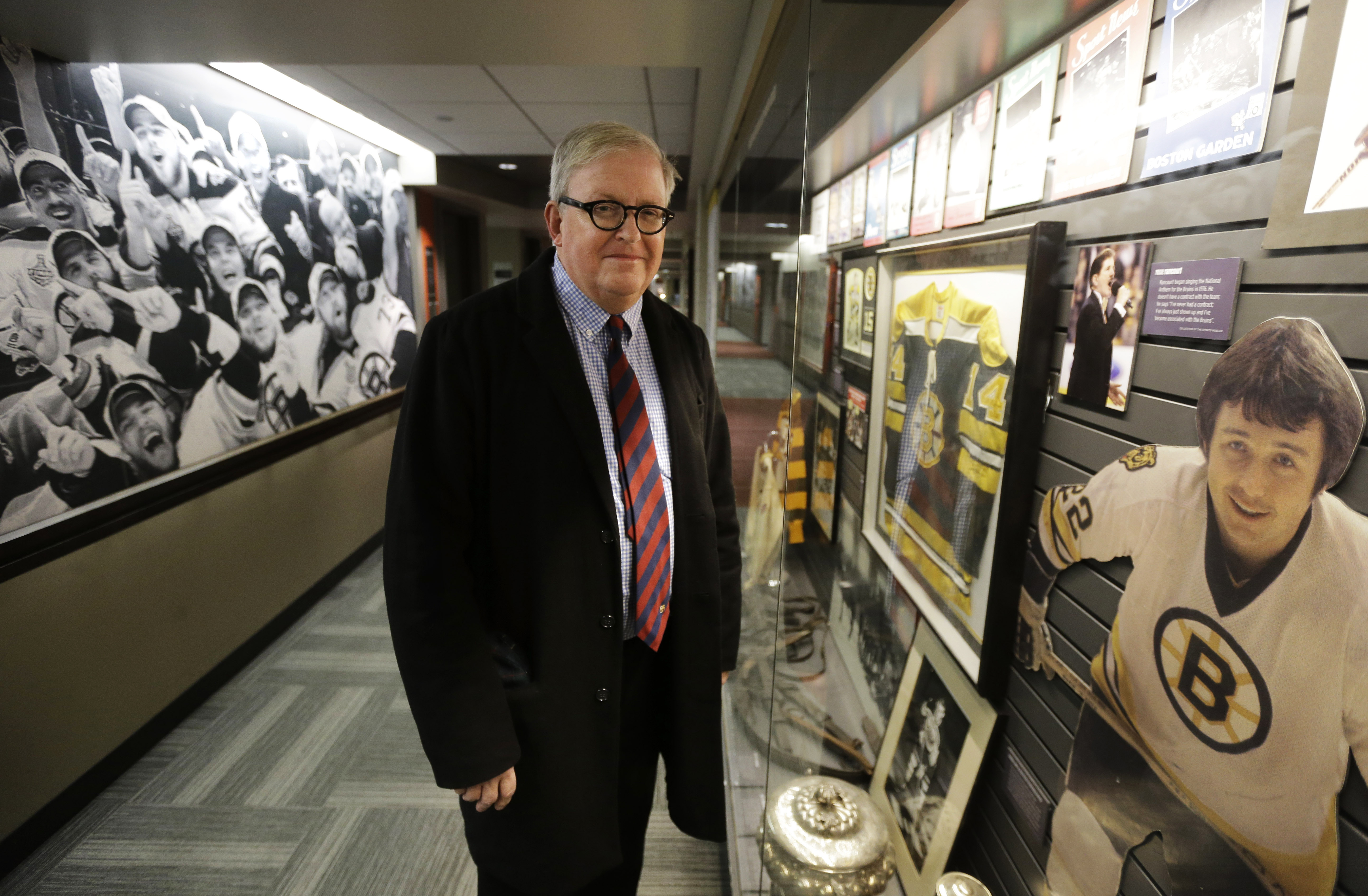 In this Thursday, Dec. 17, 2015 photo, the Sports Museum curator Richard Johnson stands near a Boston Bruins exhibit in the museum at the TD Garden, in Boston. A vast trove of New England sports artifacts is being preserved by the museum nestled inside Bo