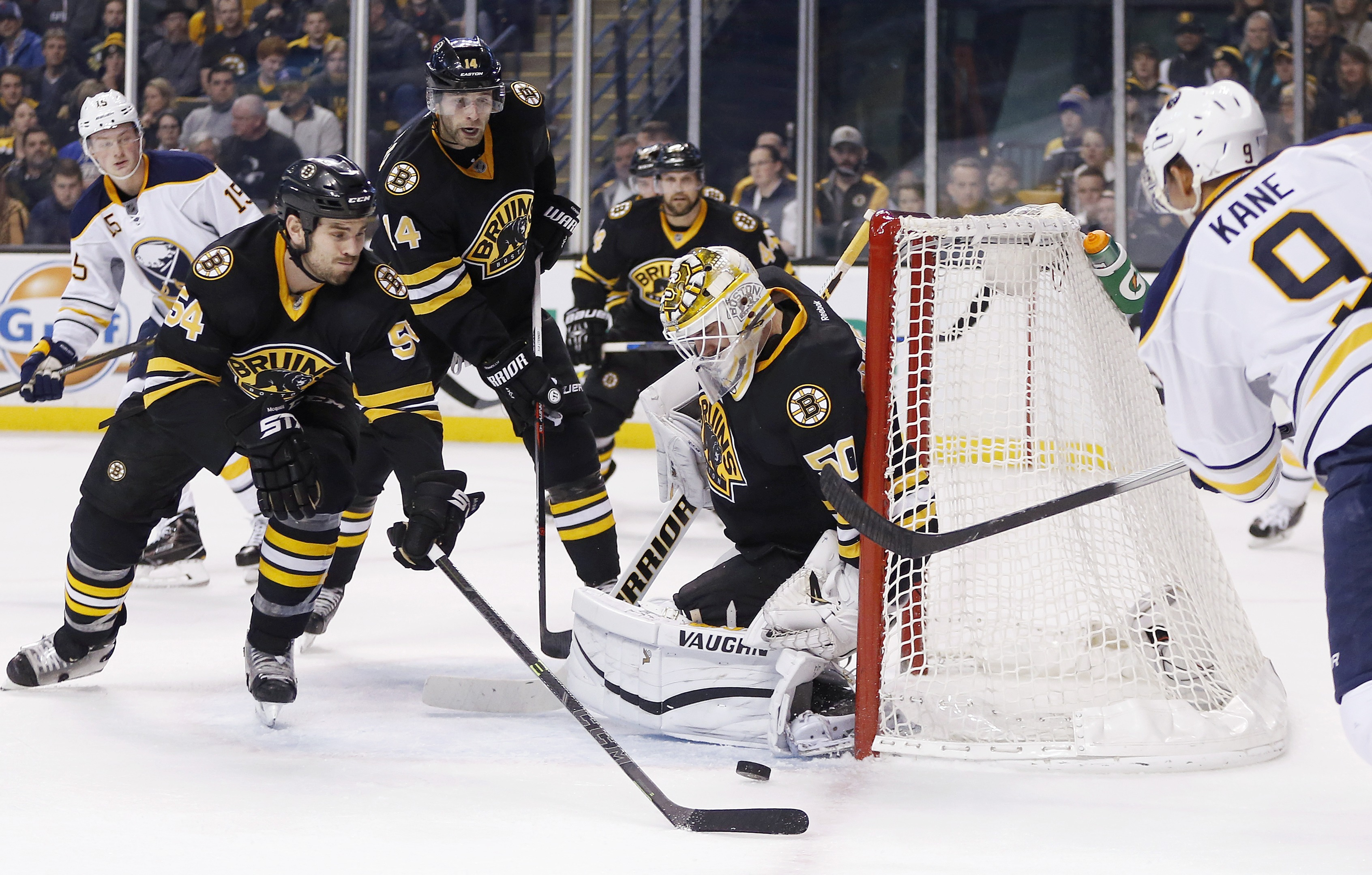 Boston Bruins' Jonas Gustavsson (50) blocks a shot by Buffalo Sabres' Evander Kane (9) during the first period of an NHL hockey game in Boston, Saturday, Dec. 26, 2015. (AP Photo/Michael Dwyer)