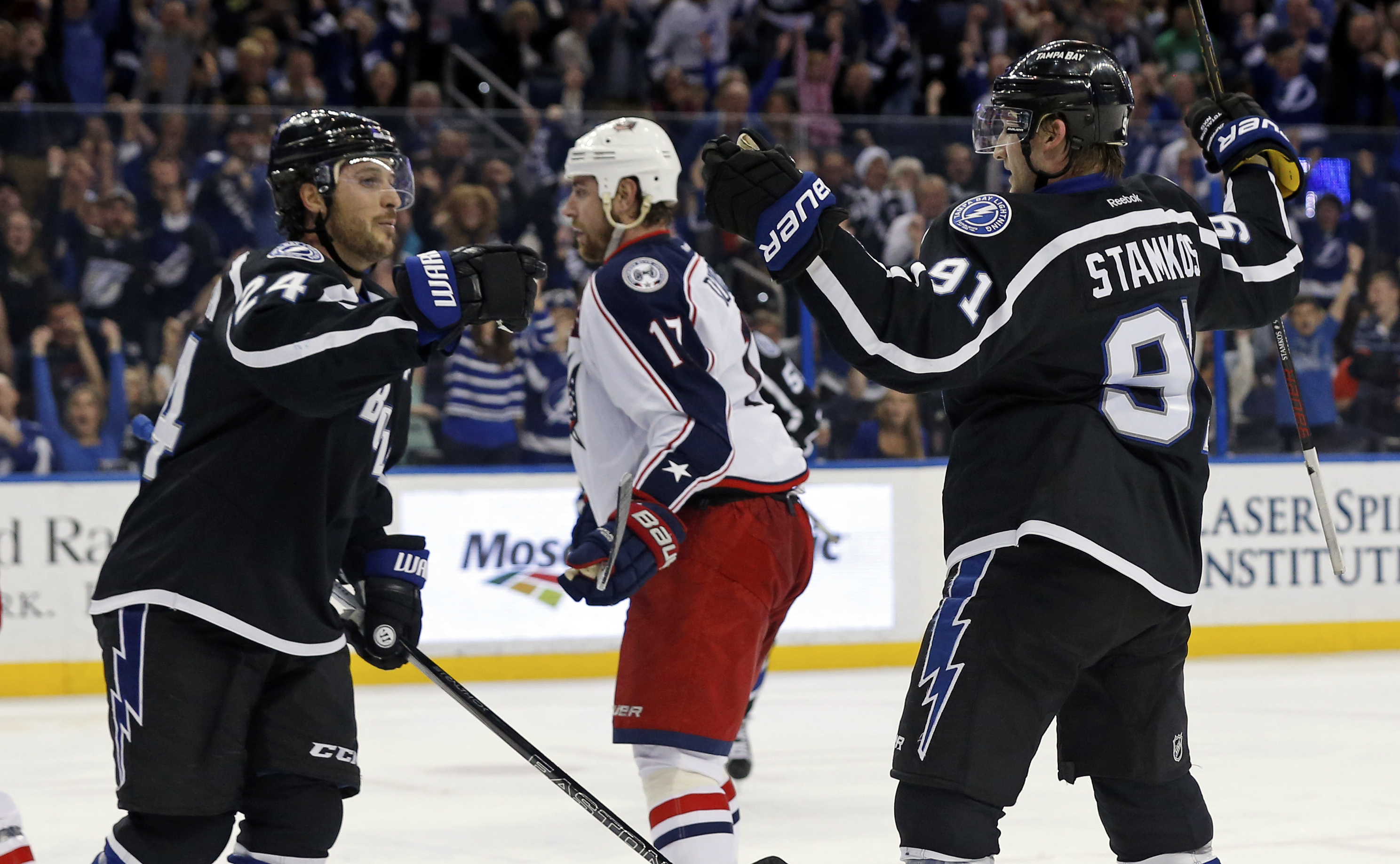Tampa Bay Lightning's Steven Stamkos, right, celebrates his second goal of the game with teammate Ryan Callahan as Columbus Blue Jackets' Brandon Dubinsky reacts during the second period of an NHL hockey game Saturday, Dec. 26, 2015, in Tampa, Fla. (AP Ph